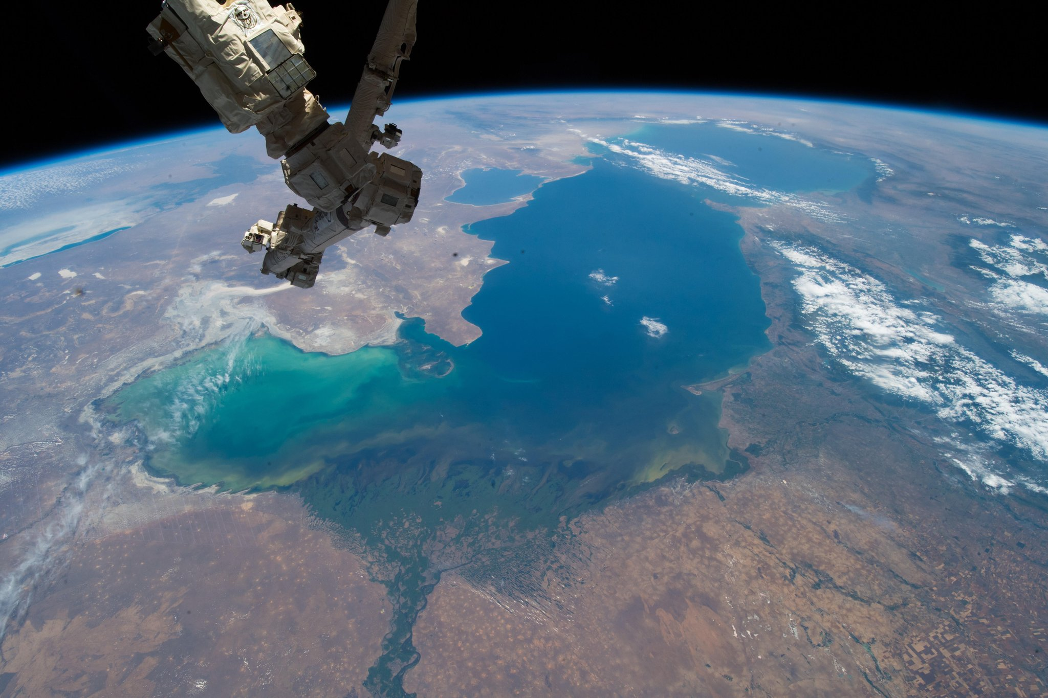 The Caspian Sea with the enormous Volga River delta on one side, and Iran on the other side. I would love to travel there one day...  (Photo & Caption: Alexander Gerst / NASA)