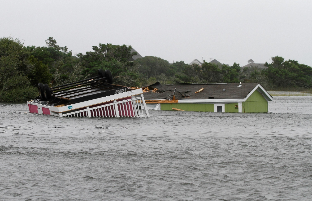 Two trailers sit overturned in the creek behind the Hatteras Sands Campground in Hatteras, N.C., Saturday, Sept. 3, 2016 after Tropical Storm Hermine passed the Outer Banks.  The storm is expected to dump several inches of rain in parts of coastal Virginia, Maryland, Delaware, New Jersey and New York as the Labor Day weekend continues.  (AP Photo/Tom Copeland)