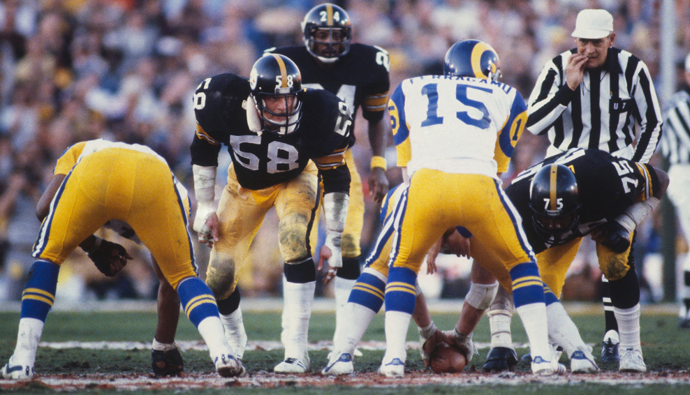 Jack Lambert of the Pittsburgh Steelers eyes Los Angeles Rams quarterback Vince Ferragamo, who calls for the snap during Super Bowl XIV at the Rose Bowl on Jan. 20, 1980 in Pasadena, Calif. The Steelers won 31-19. (Photo by Focus on Sport/Getty Images)