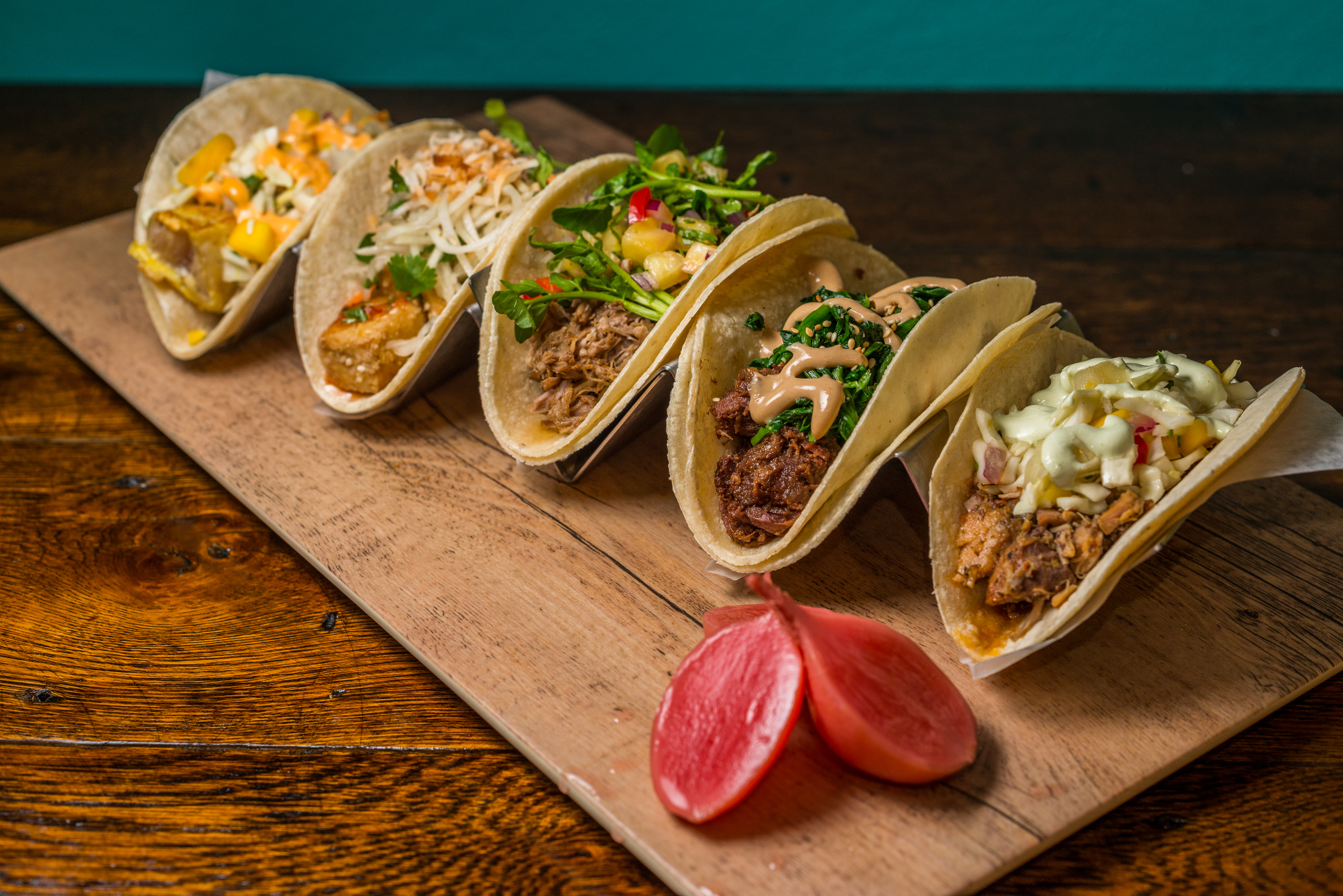 But the chef – who cut his teeth at Thunder Burger & Bar and the now-shuttered Rialto here in D.C., as well as the Royal Kona Resort on the Hawaii's Big Island – didn't want to do a straightforward taqueria. (Image: Courtesy Tiki Taco)