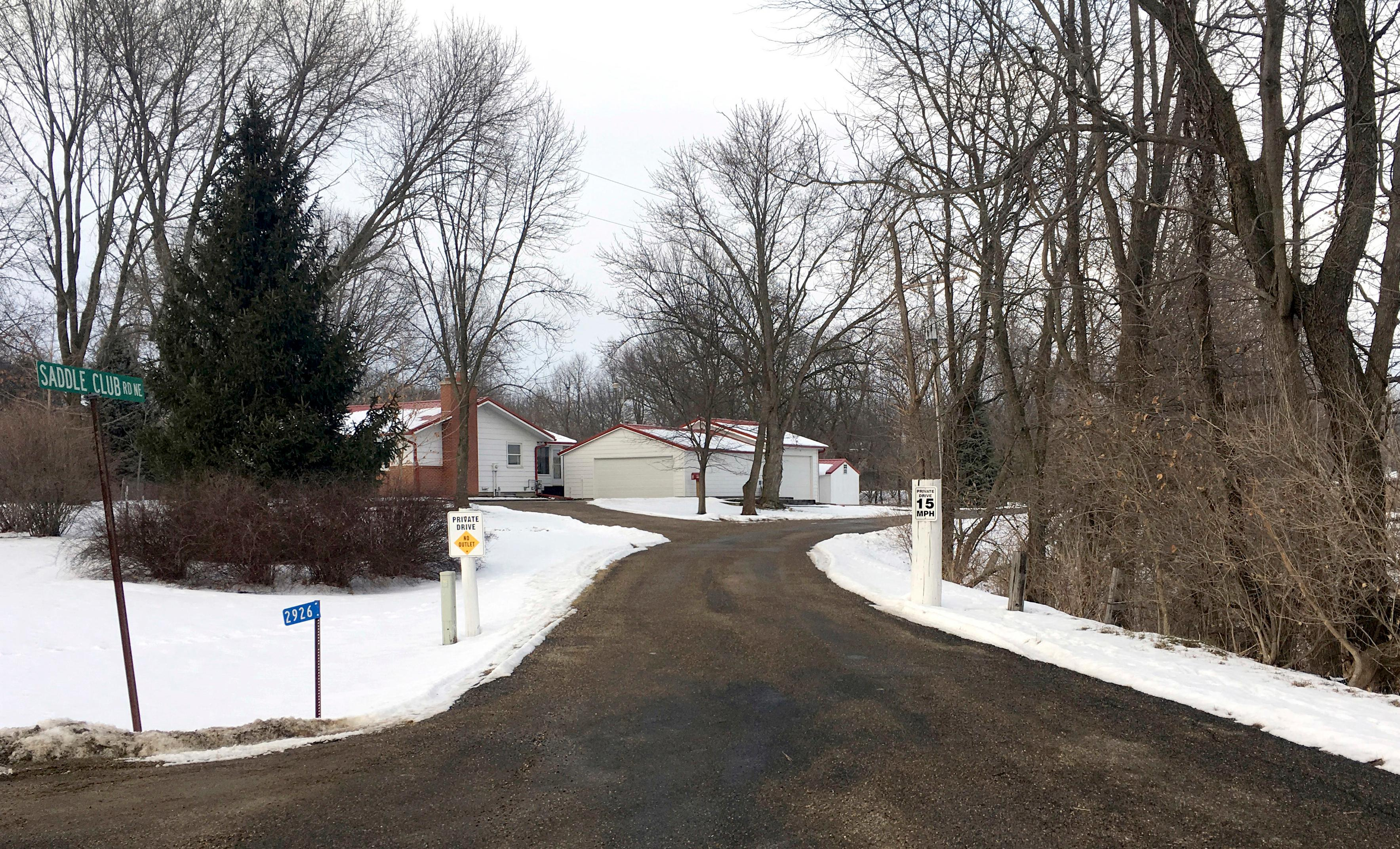 This Tuesday, Jan . 9, 2018, photo shows the entrance to Saddle Club Road in Iowa City, Iowa. The surface of the private road and who pays for its maintenance is one of many disputes that has pitted Iowa football head coach Kirk Ferentz and his wife Mary against the three other families who live along it. A trial is scheduled for next month over whether trees and landscaping items installed by the Ferentzes along the road amount to a trespass violation. (AP Photo/Ryan J. Foley)