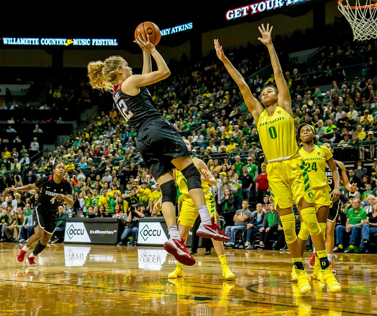 The Cardinal's Brittany McPhee (#12) goes up for jump shot against the Ducks. The Stanford Cardinal defeated the Oregon Ducks 78-65 on Sunday afternoon at Matthew Knight Arena. Stanford is now 10-2 in conference play and with this loss the Ducks drop to 10-2. Leading the Stanford Cardinal was Brittany McPhee with 33 points, Alanna Smith with 14 points, and Kiana Williams with 14 points. For the Ducks Sabrina Ionescu led with 22 points, Ruthy Hebard added 16 points, and Satou Sabally put in 14 points. Photo by August Frank, Oregon News Lab