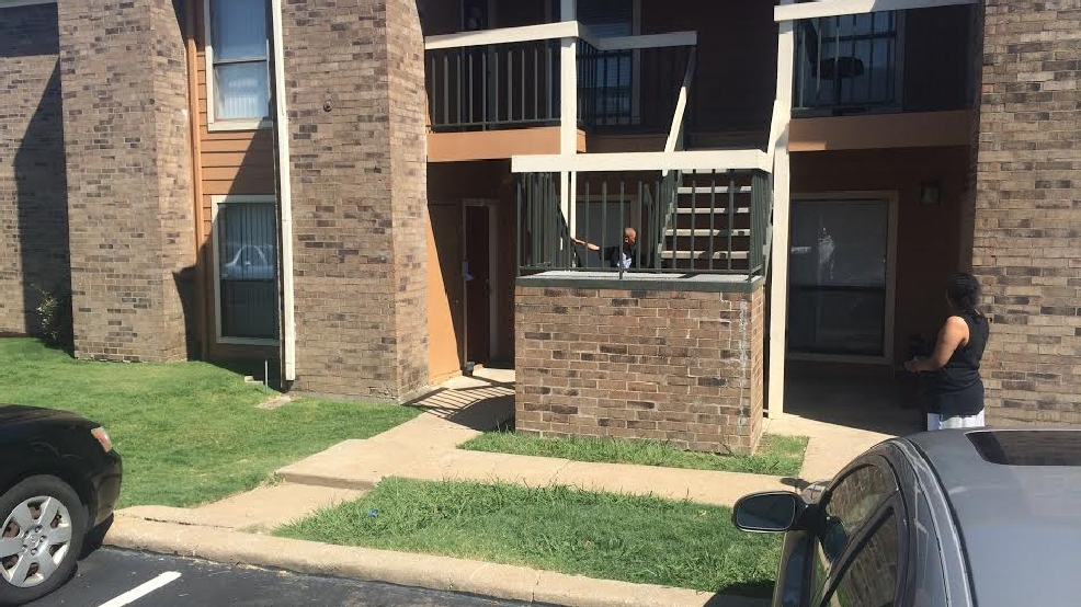 man shot and killed after opening apartment door in south