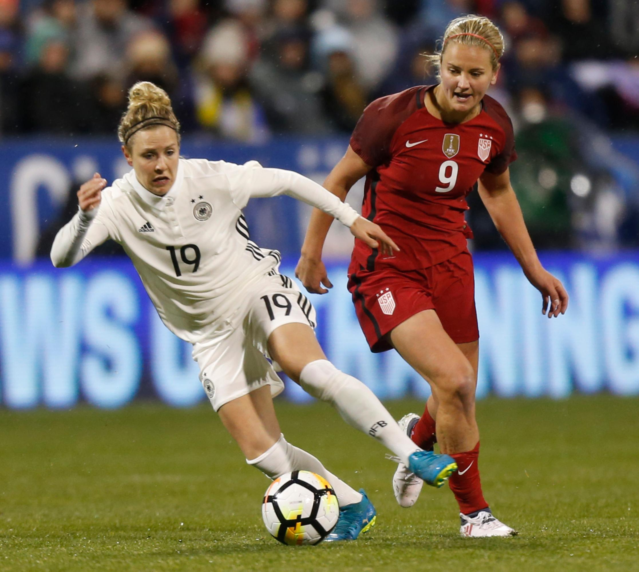 Germany's Svenja Huth, left, dribbles past United States' Lindsey Horan during the first half of a SheBelieves Cup women's soccer match Thursday, March 1, 2018, in Columbus, Ohio. (AP Photo/Jay LaPrete)