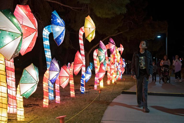 A young boy walks past a row of pinwheels on the opening night of the China Lights lantern festival Friday, January 19, 2018, at Craig Ranch Regional Park in North Las Vegas. The festival, which features nearly 50 silk and LED light displays comprised of over 1000 elements, runs through February 25th. CREDIT: Sam Morris/Las Vegas News Bureau