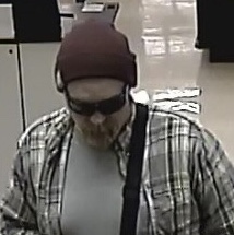 The Eugene Police Department is seeking public assistance in identifying a man who police reported robbed the U.S. Bank at Albertson's on Royal Avenue.{ }
