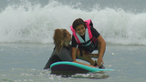 Surfing program seeks to create smiles with autistic children