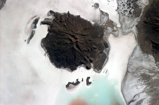 Hard brown ship of rock, adrift on a sea of salt.  (Photo & Caption: Col. Chris Hadfield, NASA)