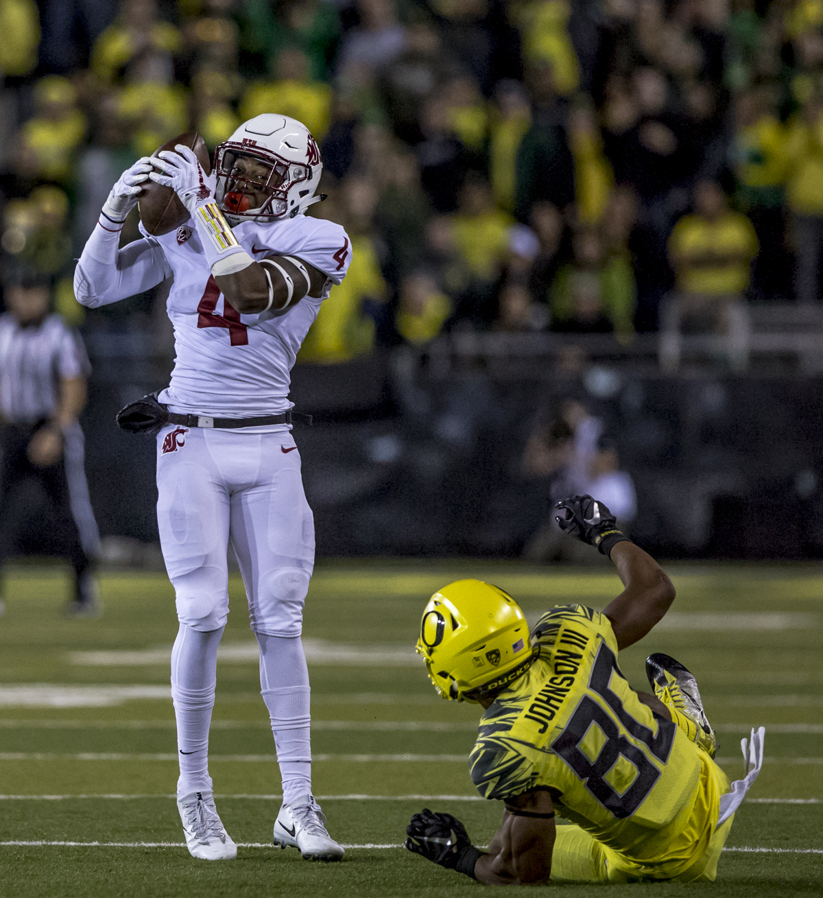 Washington State center back Thomas Graham Jr. (#4) intercepts a pass intended for Oregon wide receiver Johnny Johnson III (#80). The Washington State Cougars defeated the Oregon Ducks 33 to 10 on Saturday, October 7, 2017. Saturday's game was the first home loss for the Ducks under new head coach Willie Taggart. Photo by Ben Lonergan, Oregon News Lab