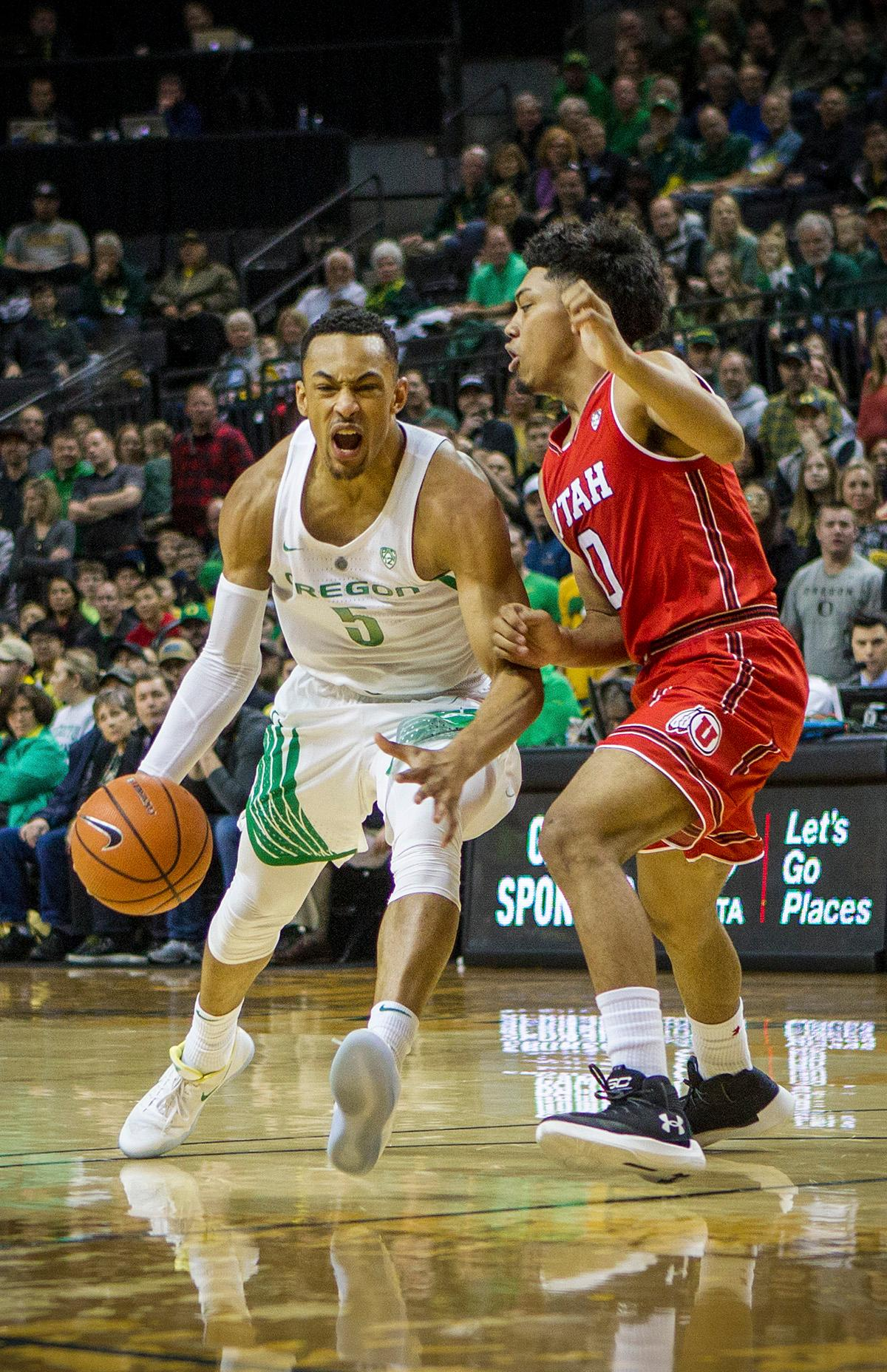 Oregon Ducks Elijah Brown (#5) makes a play past Utah's defense. The Utah Utes defeated the Oregon Ducks 66-56 on Friday night at Matthew Knight Arena. This is the first Pac-12 conference game loss at home for the Ducks since January of 2015. This also ended the five home game winning streak for the Ducks against the Utah Utes. Photo by Rhianna Gelhart, Oregon News Lab