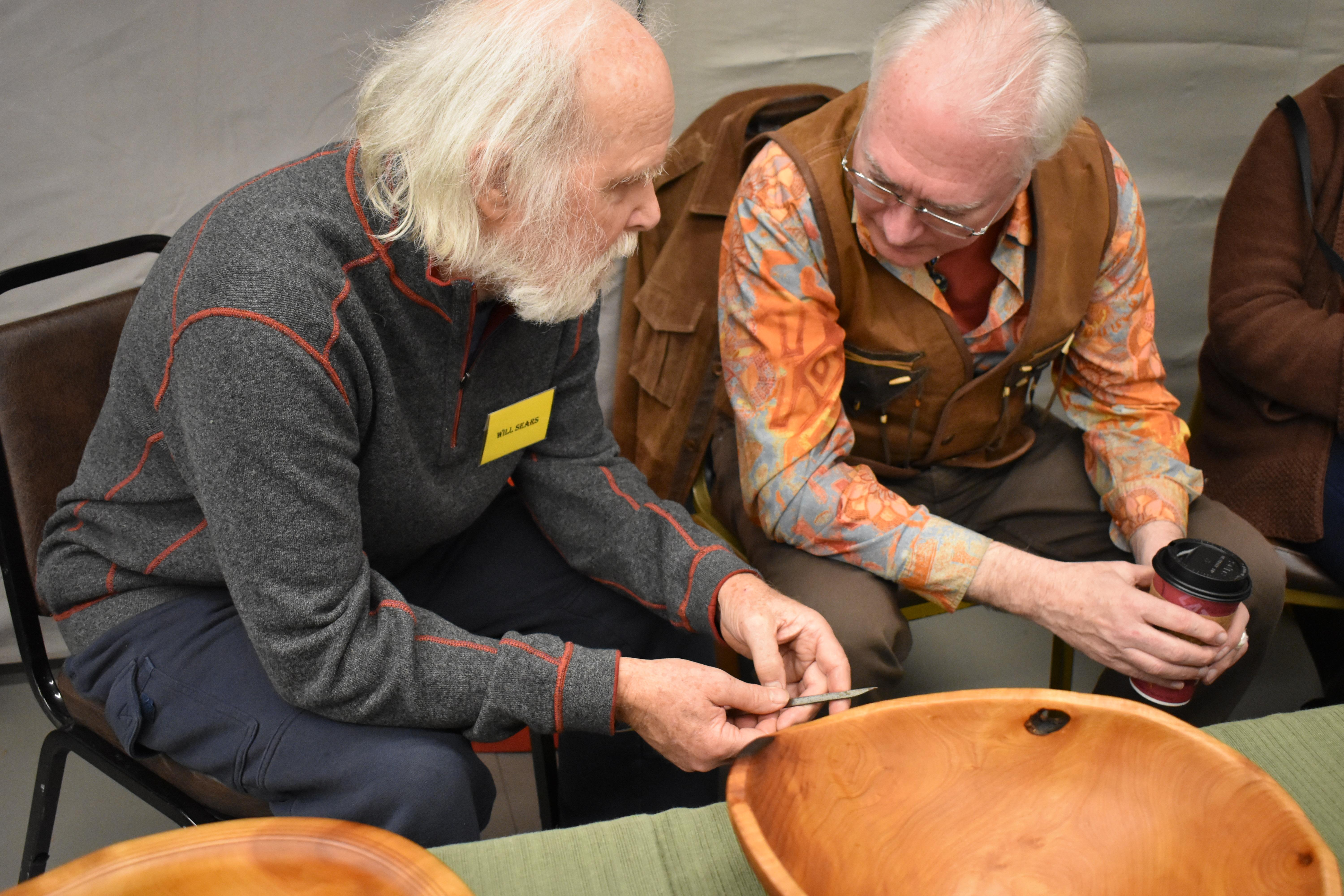 Woodworker Will Sears shows Ray Barry how a woodworker who crafts musical instruments would use a chisel. The chisel is a woodworking tool owned by Barry's grandfather, Gustav Theodore Mellquist. Photo by Maureen Flanagan Battistella