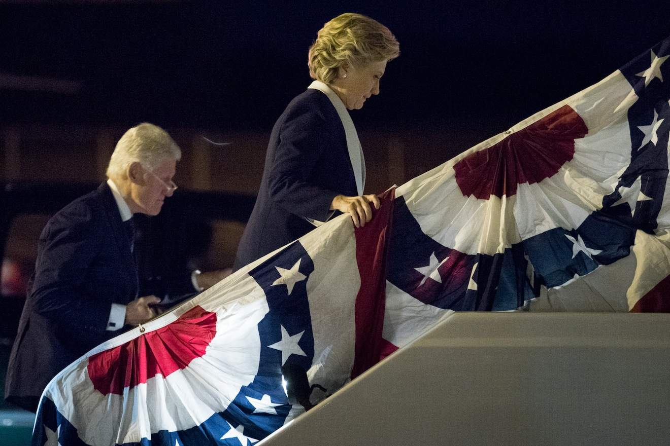 Democratic presidential candidate Hillary Clinton, center, accompanied by former President Bill Clinton, left, boards her campaign plane at LambertþÄìSt. Louis International Airport in St. Louis, N.Y., Sunday, Oct. 9, 2016, following the second presidential debate at Washington University. (AP Photo/Andrew Harnik)