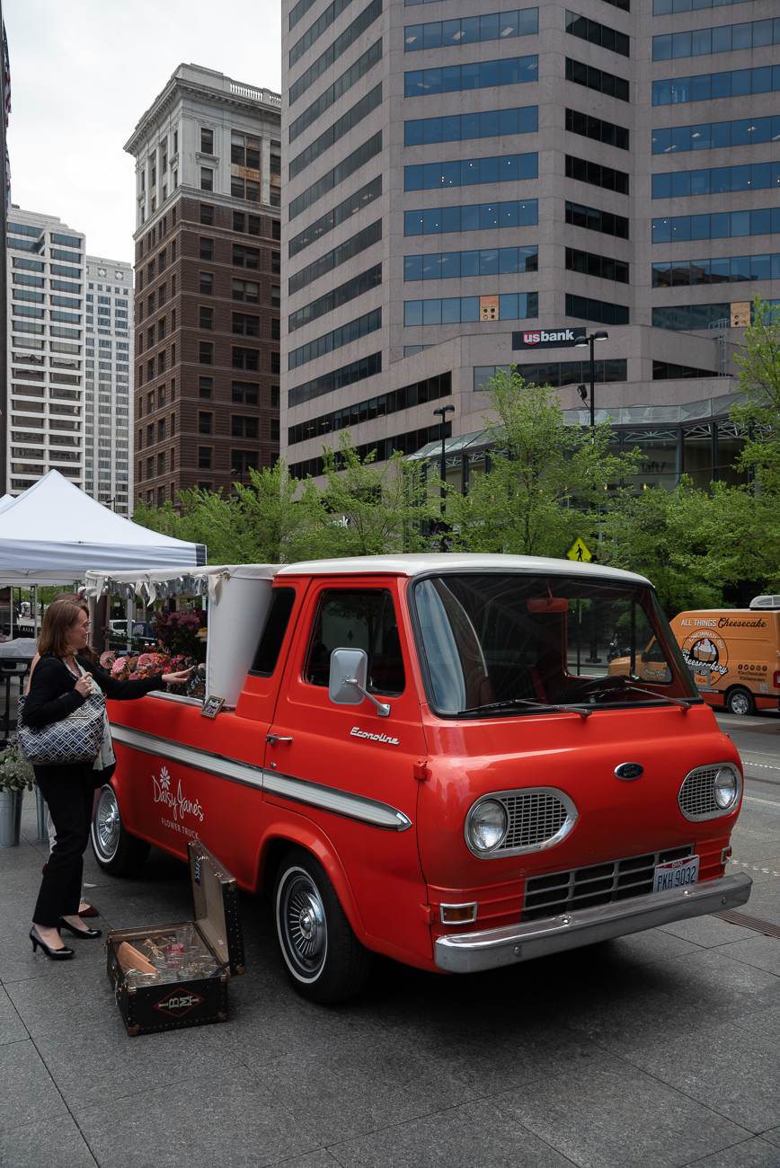 From the back of a 1965 Ford E100 truck, entrepreneur Megan Moore sells floral bouquets at different locations around Cincinnati Monday through Friday (and at events on the weekends). She was inspired to start Daisy Jane's Flower Truck after seeing a friend post about a flower truck in Nashville, TN, and realizing Cincinnati didn't have one of its own. After leaving her position as a reporter for Local 12 WKRC-TV at the end of 2018, Megan pursued her dream of making others' lives happier by starting the flower truck. / Image: Phil Armstrong, Cincinnati Refined // Published: 5.5.19