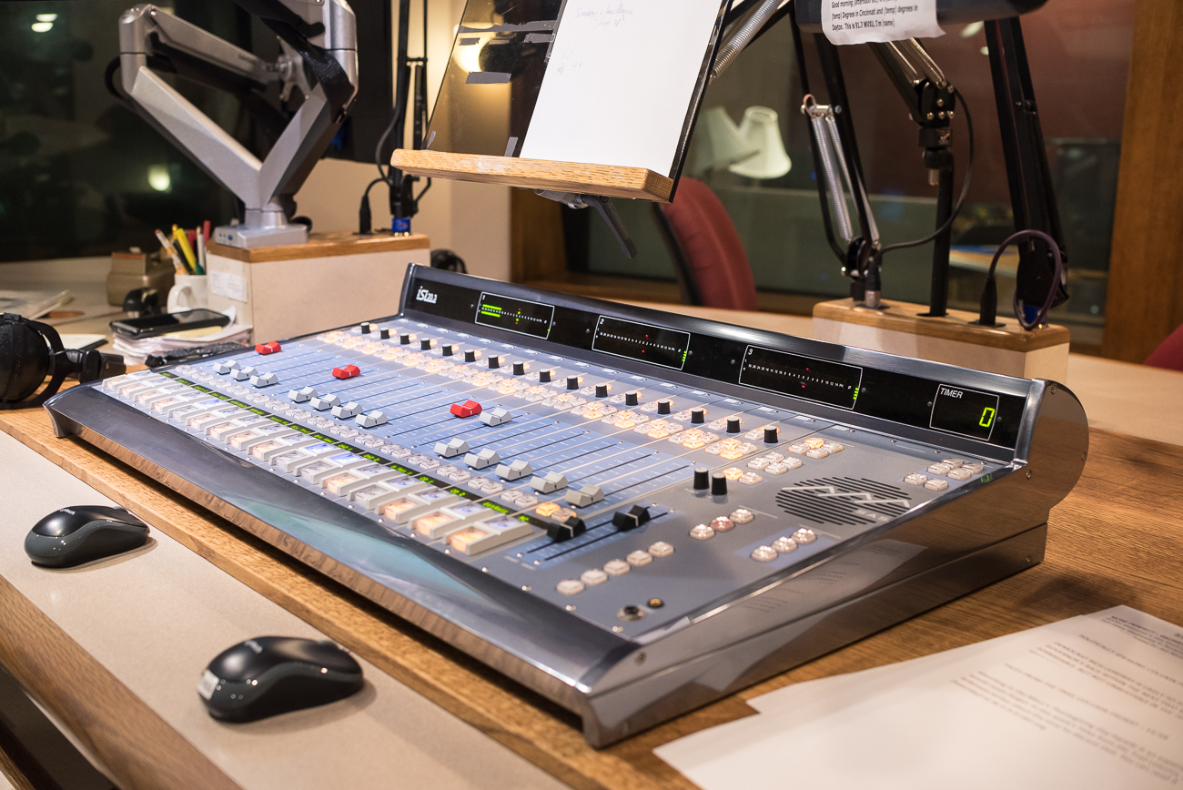 The control board is how the broadcaster switches between the national NPR feed and their own live readings. It is located on the desk directly below the microphone. / Image: Phil Armstrong, Cincinnati Refined // Published: 12.12.17