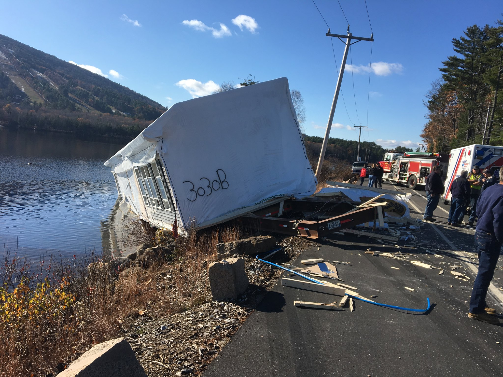 Police say a tractor-trailer that was hauling a modular home has plunged into Moose Pond in Bridgton. (Bridgton Police Department)<p></p>