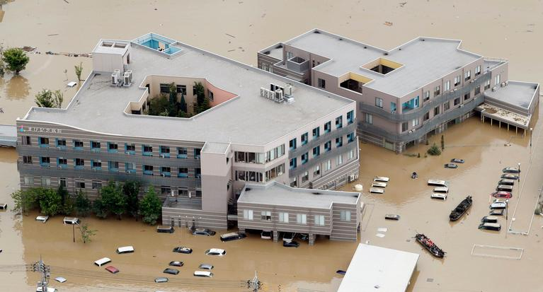 A hospital is flooded by muddy water following heavy rain in Kurashiki city, Okayama prefecture, southwestern Japan, Sunday, July 8, 2018. Heavy rainfall hammered southern Japan for the third day, prompting new disaster warnings on Kyushu and Shikoku islands on Sunday. (Shohei Miyano/Kyodo News via AP)