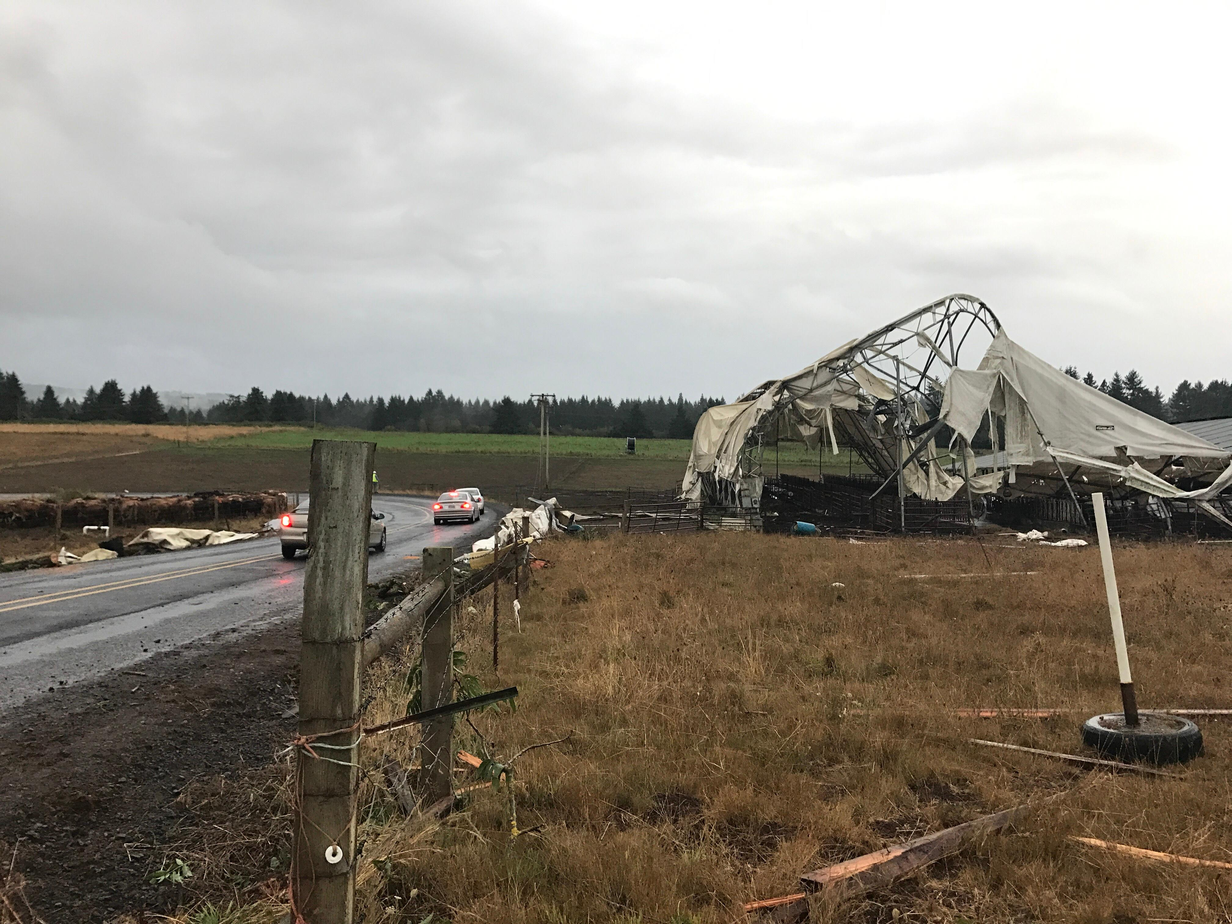 A funnel cloud touched down near Lebanon, Oregon on Tuesday, causing damage to four barns in the area.