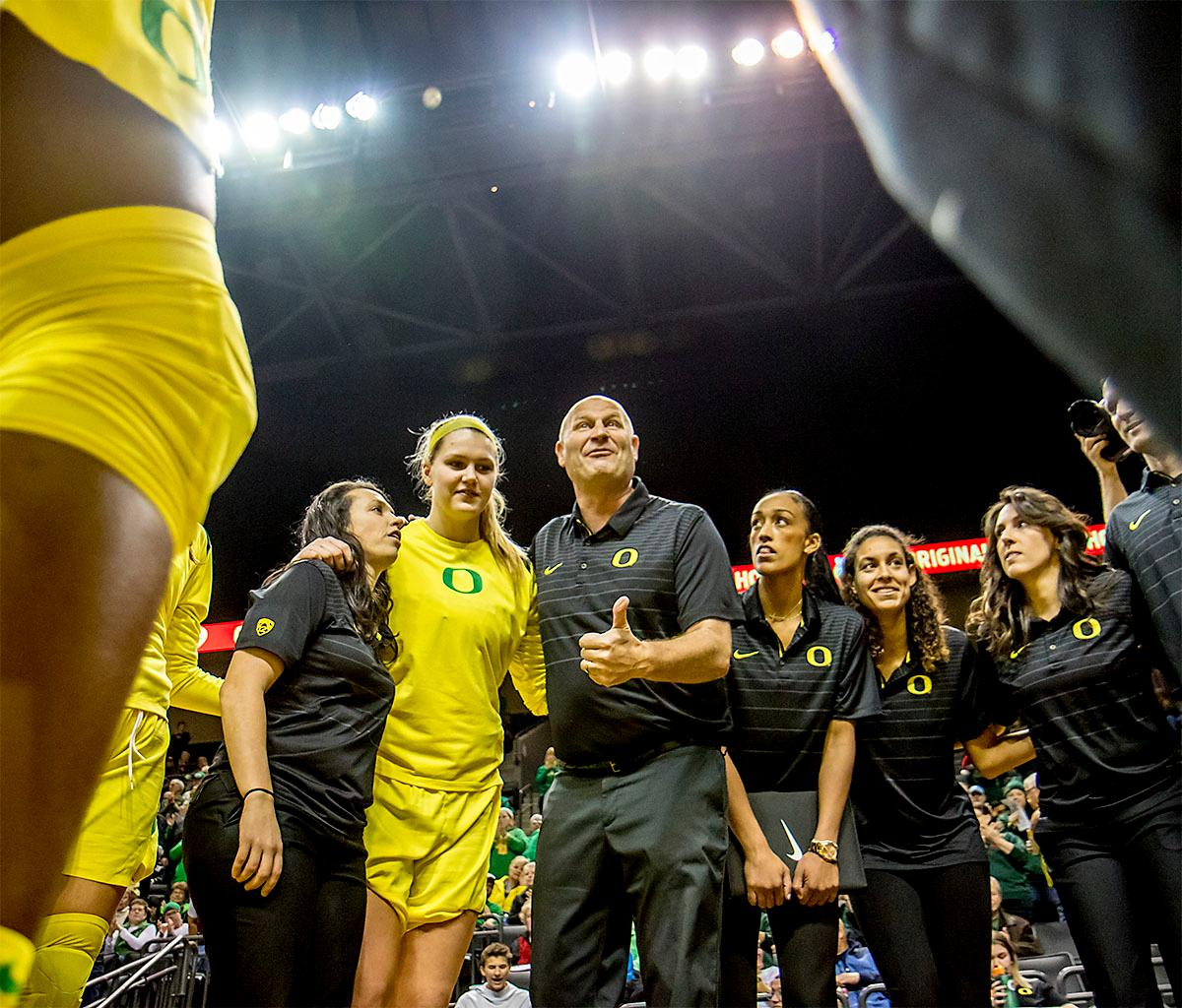 Oregon Ducks Head Coach Kelly Graves talks to his team before the start of the game. The Duck's Sabrina Ionescu (#20) is introduced at the start of the game against the Ole Miss Rebels. The Oregon Ducks womens basketball team defeated the Ole Miss Rebels 90-46 on Sunday at Matthew Knight Arena. Sabrina Ionescu tied the NCAA record for triple-doubles, finishing the game with 21 points, 14 assists, and 11 rebounds. Ruthy Hebard added 16 points, Satou Sabally added 12, and both Lexi Bando and Maite Cazorla scored 10 each. The Ducks will next face off against Texas A&M on Thursday Dec. 21 and Hawaii on Friday Dec. 22 in Las Vegas for Duel in the Desert before the start of Pac-12 games. Photo by August Frank, Oregon News Lab