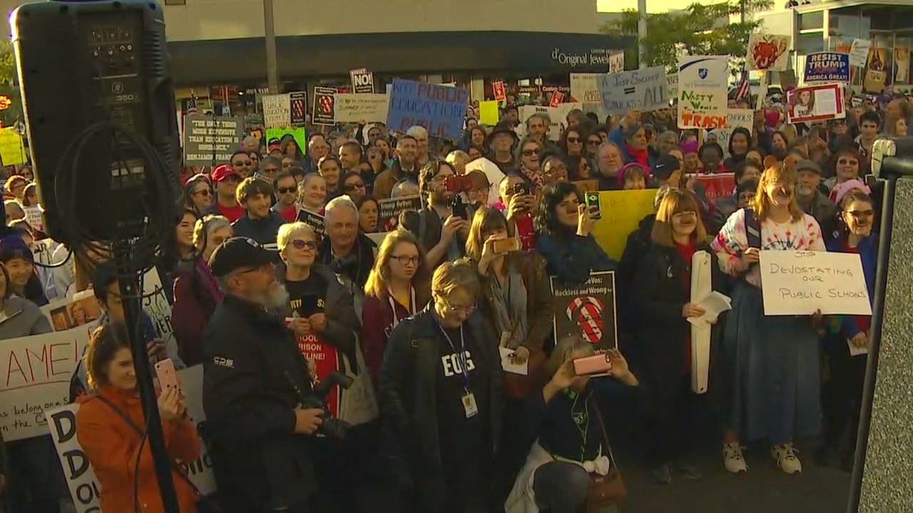 Protesters gather in Bellevue, Wash., to demonstrate against Education Secretary Betsy DeVos on Friday, Oct. 12, 2017. (Photo: KOMO News)<p></p>