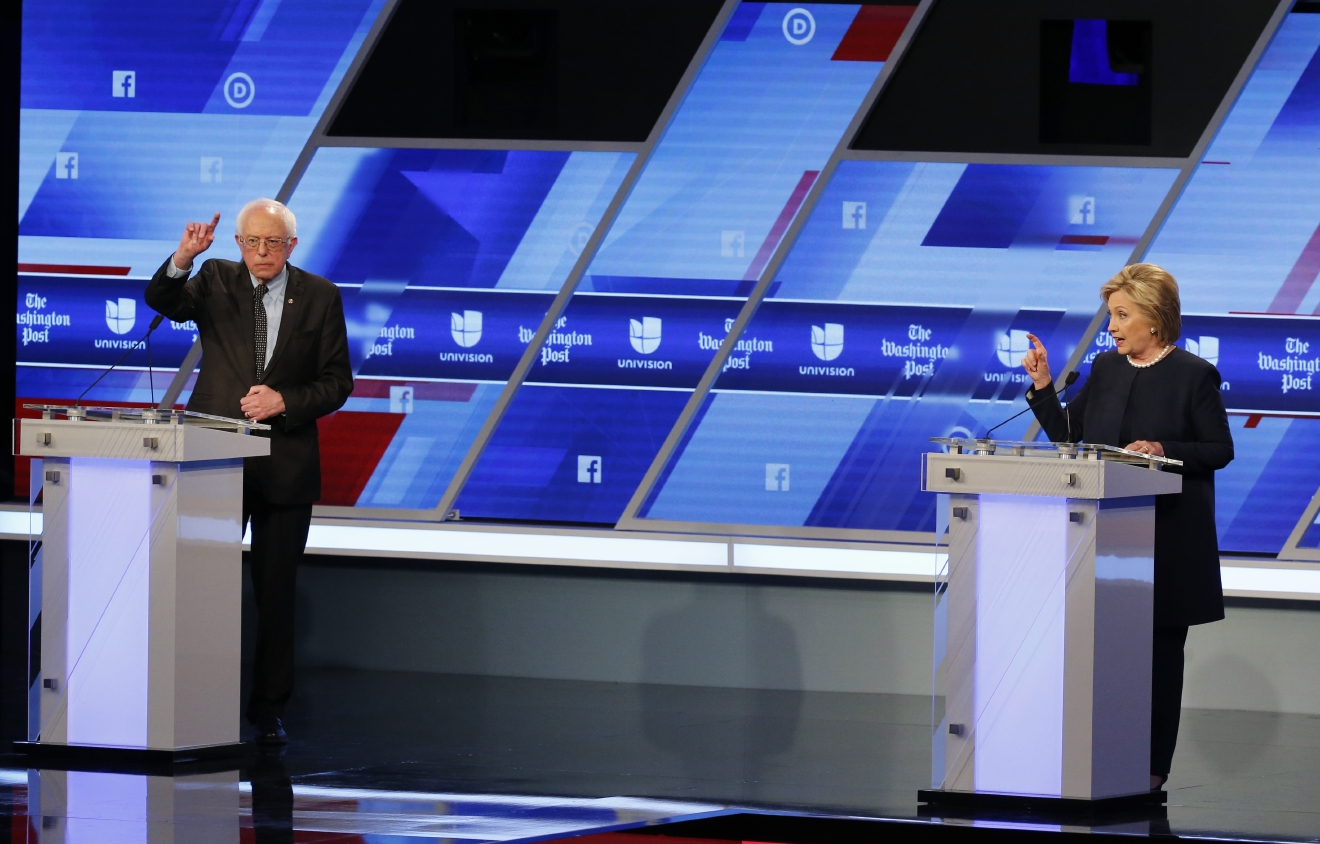 Democratic presidential candidates, Sen. Bernie Sanders, I-Vt,  and Hillary Clinton interrupt each other during the Univision, Washington Post Democratic presidential debate at Miami-Dade College,  Wednesday, March 9, 2016, in Miami. (AP Photo/Wilfredo Lee)