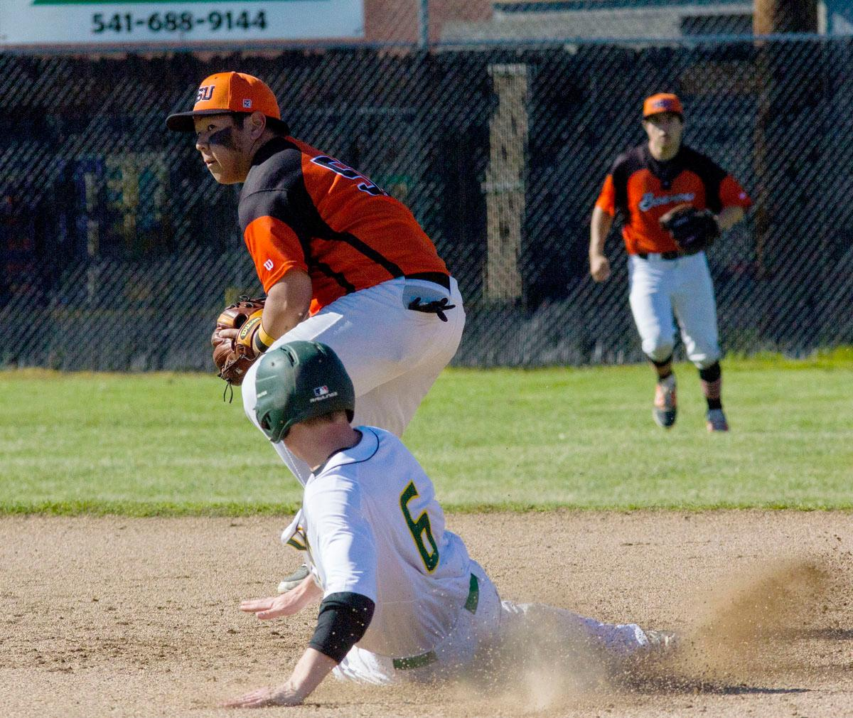 The Oregon State second baseman attempts to turn a double play after getting Oregon Ducks Austin Smith out. The Oregon Ducks won the Civil War series this weekend against the Oregon State Beavers. The Ducks won the first game 13-3, but lost the second game 12-0, then rebounding to win the third and deciding game 4-3. The Ducks Club baseball team finished the season with a league record of 14-1, taking first place. They now move on to the Regionals in Boise, Idaho, in two weeks. The Club team won the National Championship in 2015 and came in third nationally in 2016. Photo by Aaron Alter, Oregon News Lab