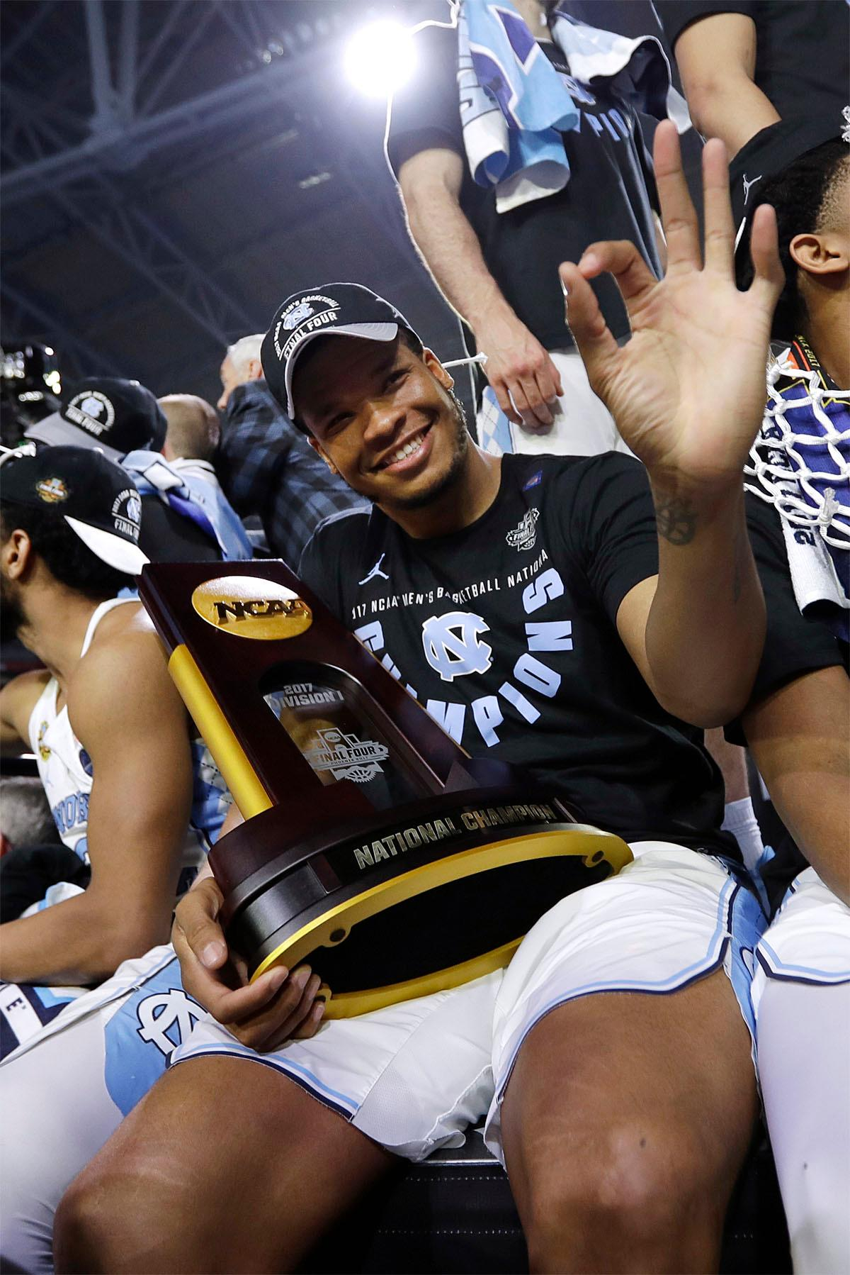 North Carolina forward Kennedy Meeks celebrates with the trophy after the championship game against Gonzaga at the Final Four NCAA college basketball tournament, Monday, April 3, 2017, in Glendale, Ariz. North Carolina 71-65. (AP Photo/David J. Phillip)