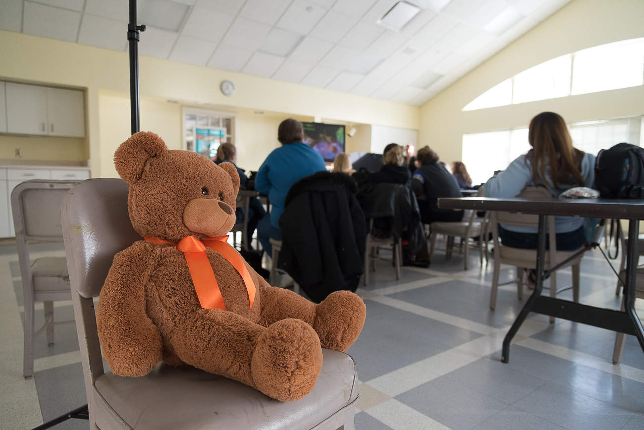 Props, such as oversized stuffed bears, give attendees of the class the chance to practice what they've learned in a controlled environment. / Image: Phil Armstrong, Cincinnati Refined // Published: 1.25.18