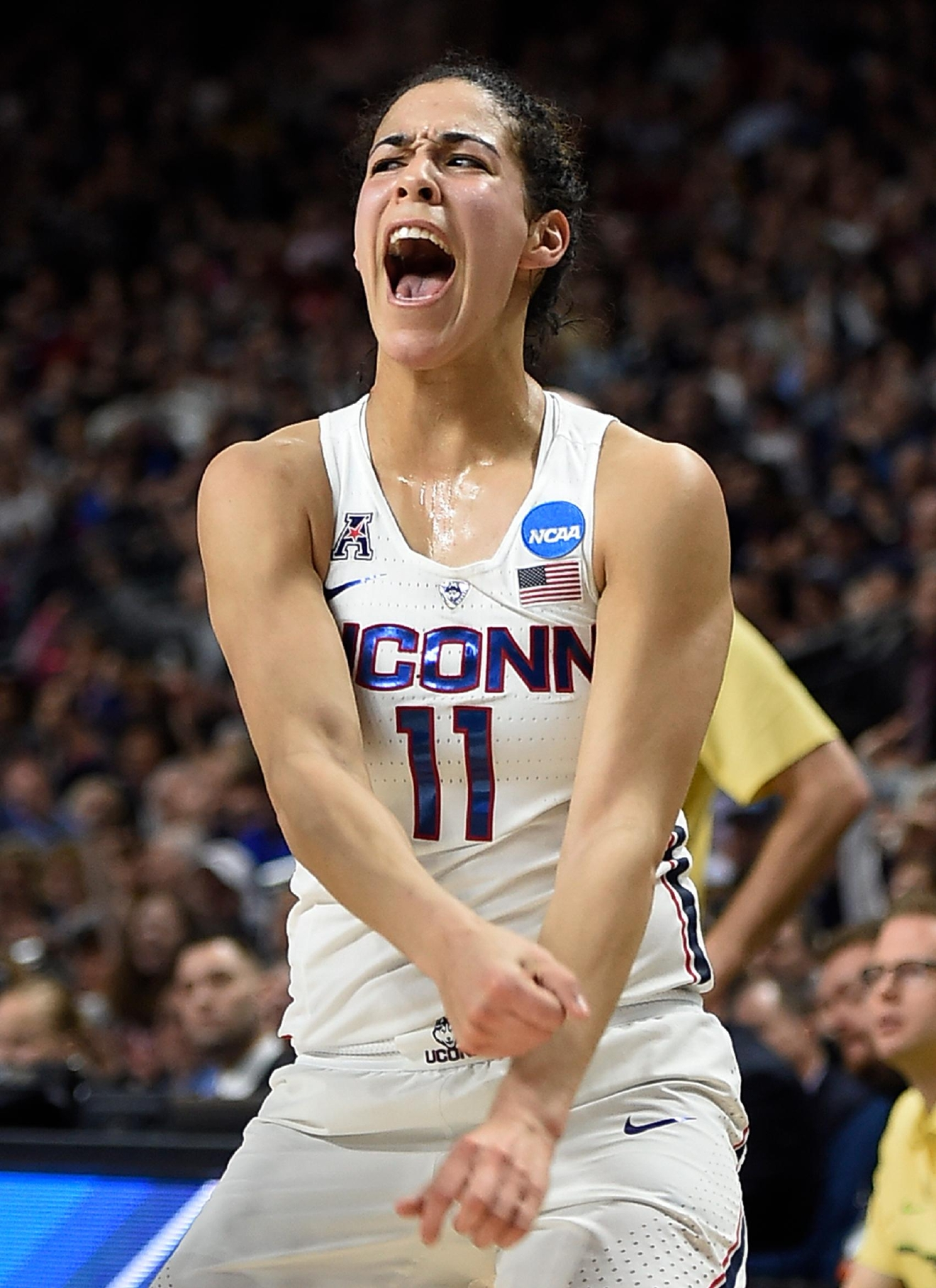 Connecticut's Kia Nurse reacts after hitting a 3-point basket during the first half of a regional final game against Oregon in the NCAA women's college basketball tournament, Monday, March 27, 2017, in Bridgeport, Conn. (AP Photo/Jessica Hill)