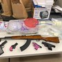 Three arrested after search reveals drugs, guns and cash