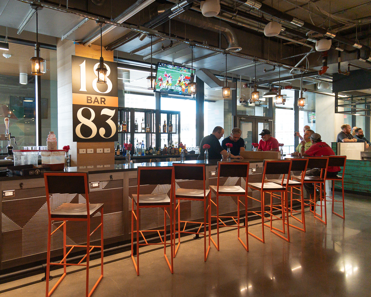 On the second level customers will find multiple local restaurants and a bar: Django Western Taco, Eli's BBQ, Queen City Whip, Dope Asian Street Food, and 1883 Cafe and Bar. The second floor is set up to comfortably host lunch and dinner, post-work happy hours, and more. It's meant as a space where people can go to hang out. Also on the second floor is plenty of seating both indoors and outside under a covered, second-story balcony. / Image: Phil Armstrong, Cincinnati Refined // Published: 9.24.19
