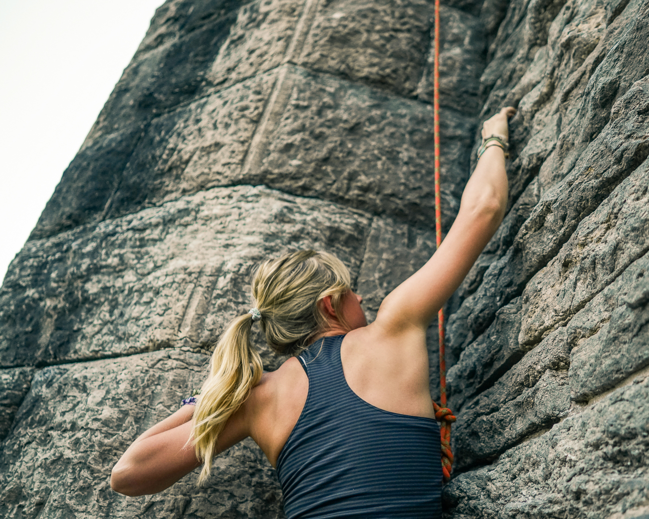 Leah Marshall demonstrates rock climbing in Eden Park. / Image: Allen Meyer // Published: 5.30.18