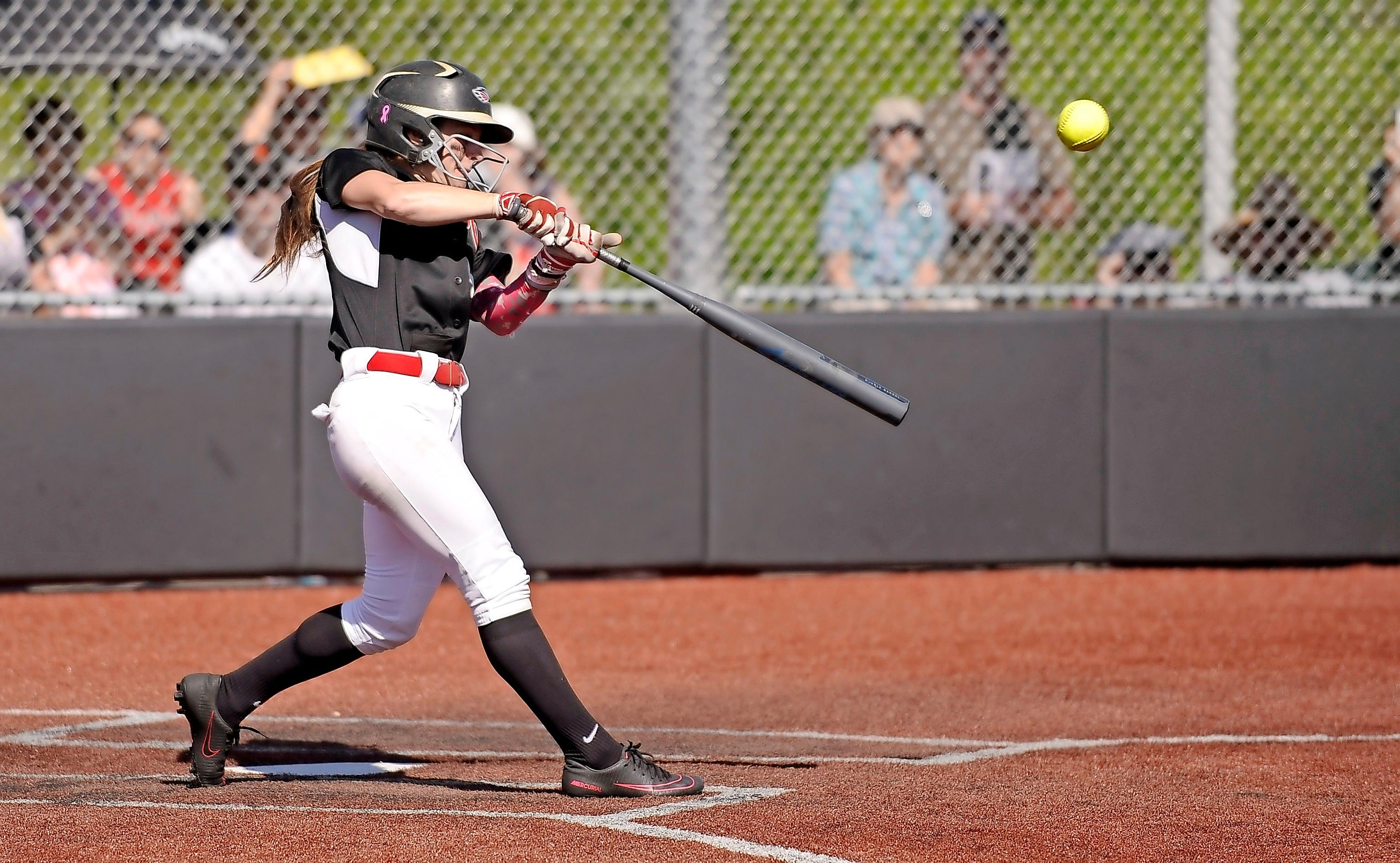 Andy Atkinson/Daily TidingsSouthern Oregon University shortstop Kelsey Randall connects for a triple to lead off the bottom of the fifth inning against Northwestern College on Tuesday. Randall scored moments later on Hannah Shimek's RBI single to center field.