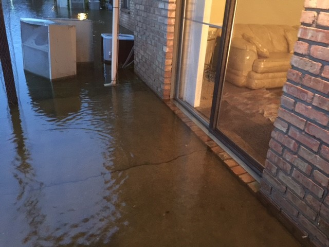 Flooding overtook a patio of an apartment in Battle Creek.