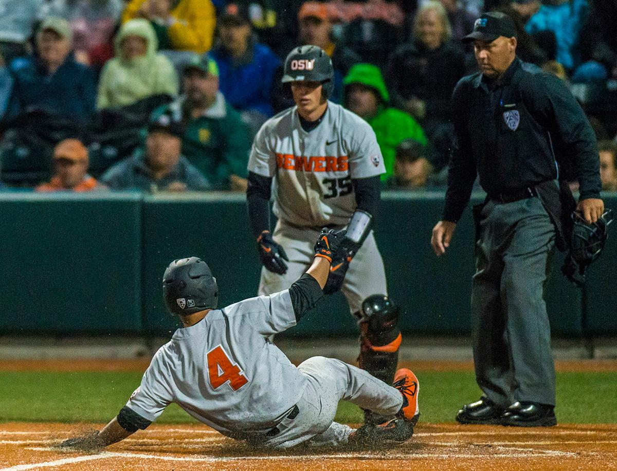 Oregon State Beavers Steven Kwan (#4) slides into home for a run. The Oregon State Beavers defeated the Oregon Ducks 5-4 in game two of the Civil War three-game series on Friday night at PK Park. This loss is the fifth straight loss for the Ducks, in which four have been by a single run. The final game of the Civil War series will be on Saturday, May 13th at 7pm. Photo by Rhianna Gelhart, Oregon News Lab
