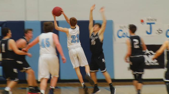 Devin Bassett floats a jumer over the North Buncombe defense (WLOS Staff).jpg