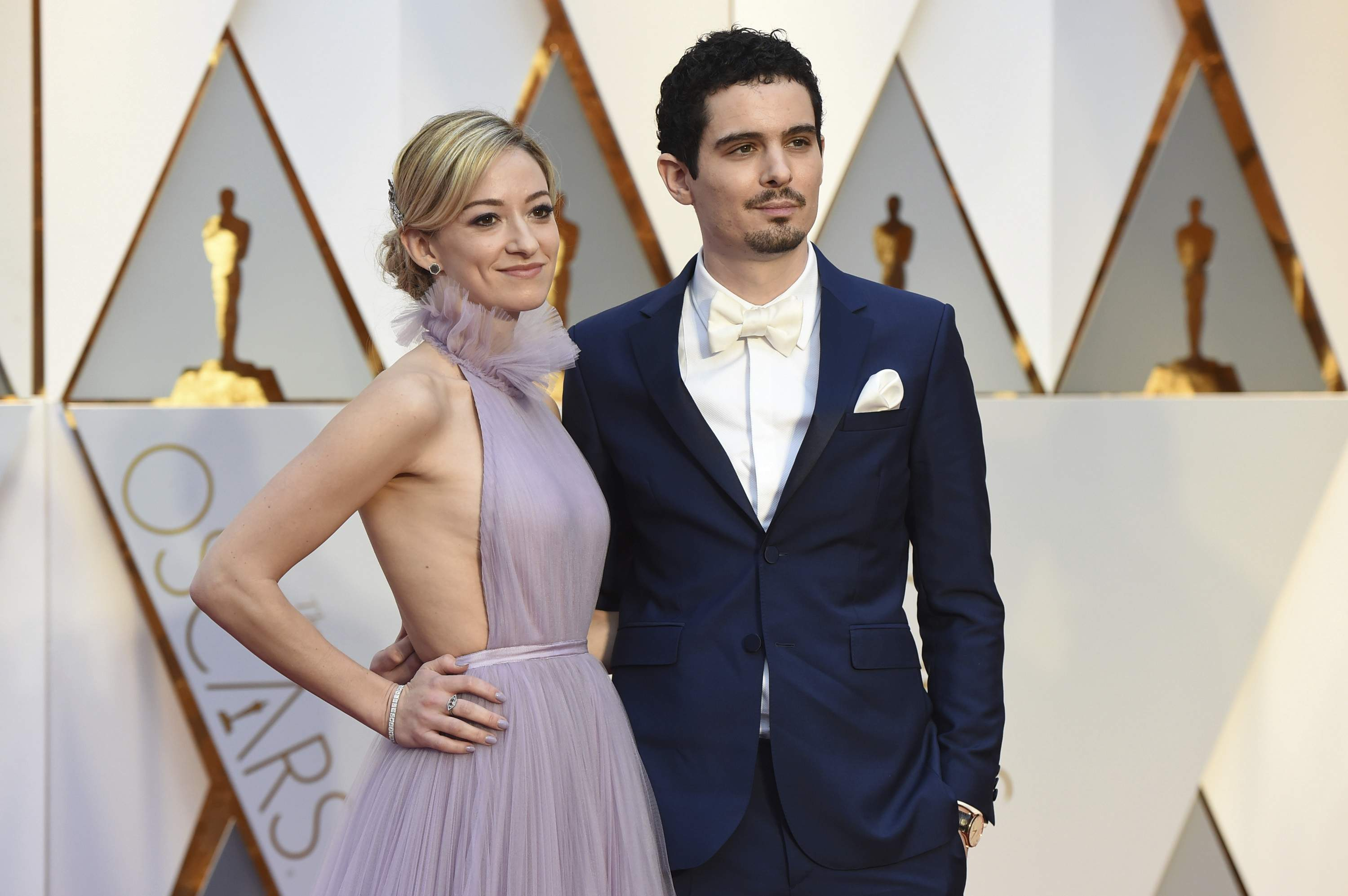 Olivia Hamilton, left, and Damien Chazelle arrive at the Oscars on Sunday, Feb. 26, 2017, at the Dolby Theatre in Los Angeles. THE ASSOCIATED PRESS
