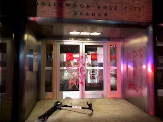 Police said a group of about 50 people vandalized businesses along Northeast Sandy Boulevard on Friday night, Nov. 20, 2020 (Courtesy Portland Police)