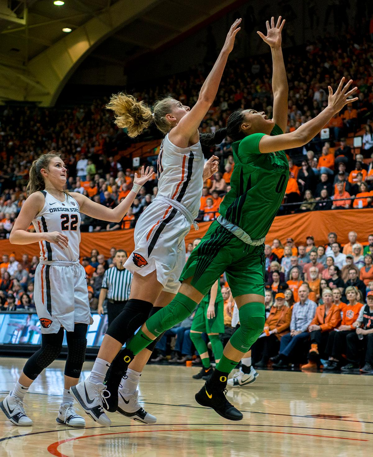 Oregon Ducks forward Satou Sabally (#0) heaves a shot toward the basket as the Oregon State Beavers defense leaps to block.The Oregon Ducks were defeated by the Oregon State Beavers 85-79 on Friday night in Corvallis. Sabrina Ionescu scored 35 points and Ruthy Hebard added 24. The Ducks will face the Beavers this Sunday at 5 p.m. at Matthew Knight Arena. Photo by Abigail Winn, Oregon News Lab