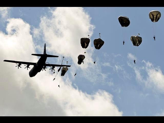 A U.S. Air Force C-130 Hercules aircraft drops U.S. and international paratroopers to commemorate the 70th anniversary of D-Day in Normandy, France, June 8, 2014.
