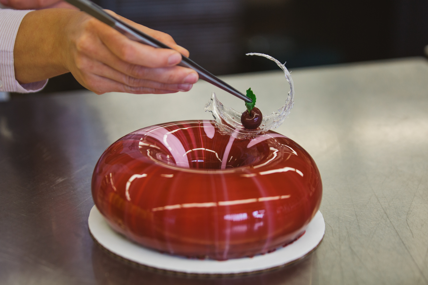 Slowly and delicately poured over delicious mousse cakes, mirror glazing takes cake aesthetic to a whole new level. At Mousse Boutique, Anastasia{ }Stratulat is a master as she carefully designs beautiful edible art pieces through her high quality minimalist designs. (Image: Ryan McBoyle / Seattle Refined)