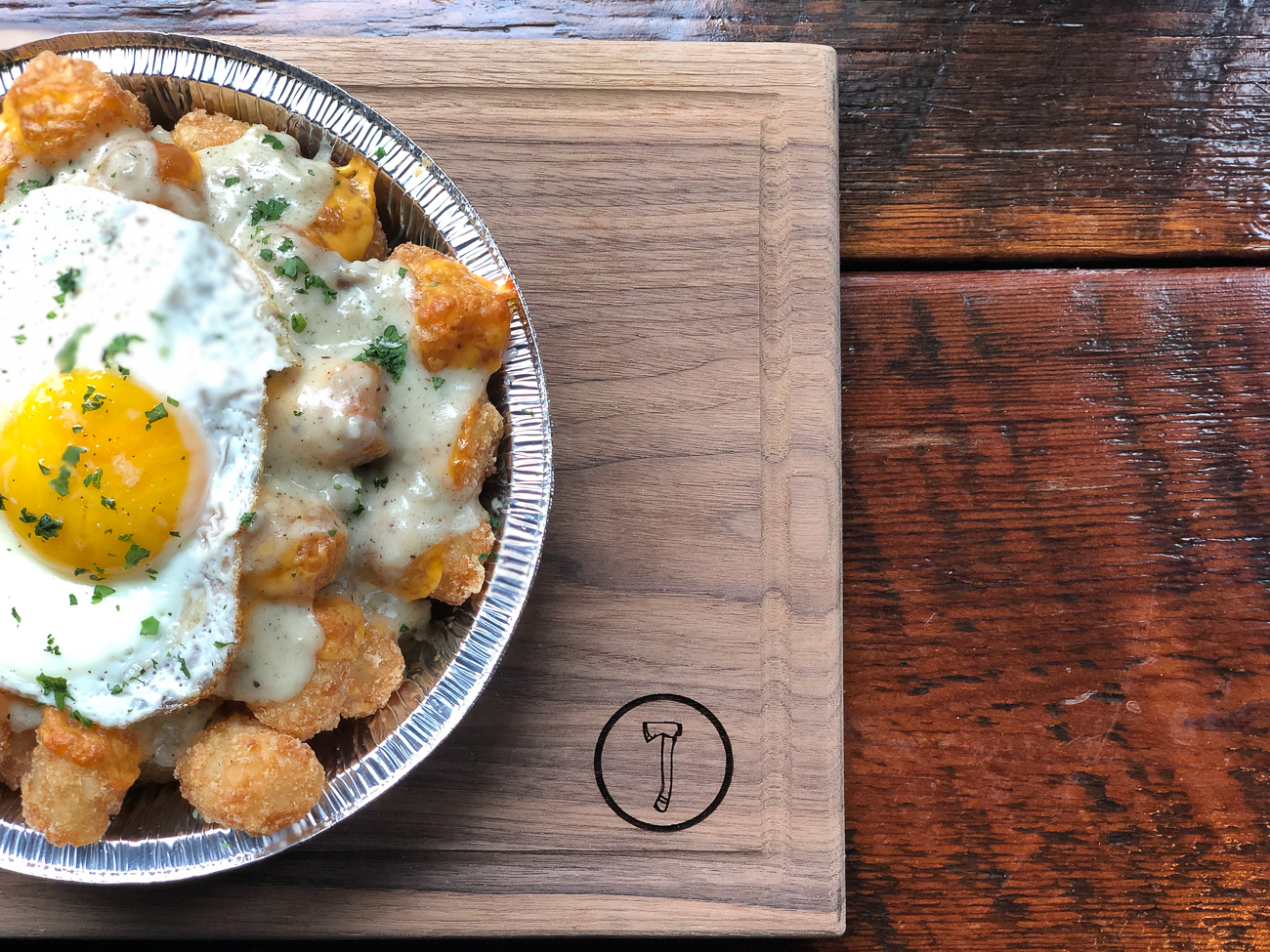 Breakfast Tots: house-made with sausage gravy, egg, and cheese / Image courtesy of Nation Kitchen and Bar // Published: 1.15.18<p></p>