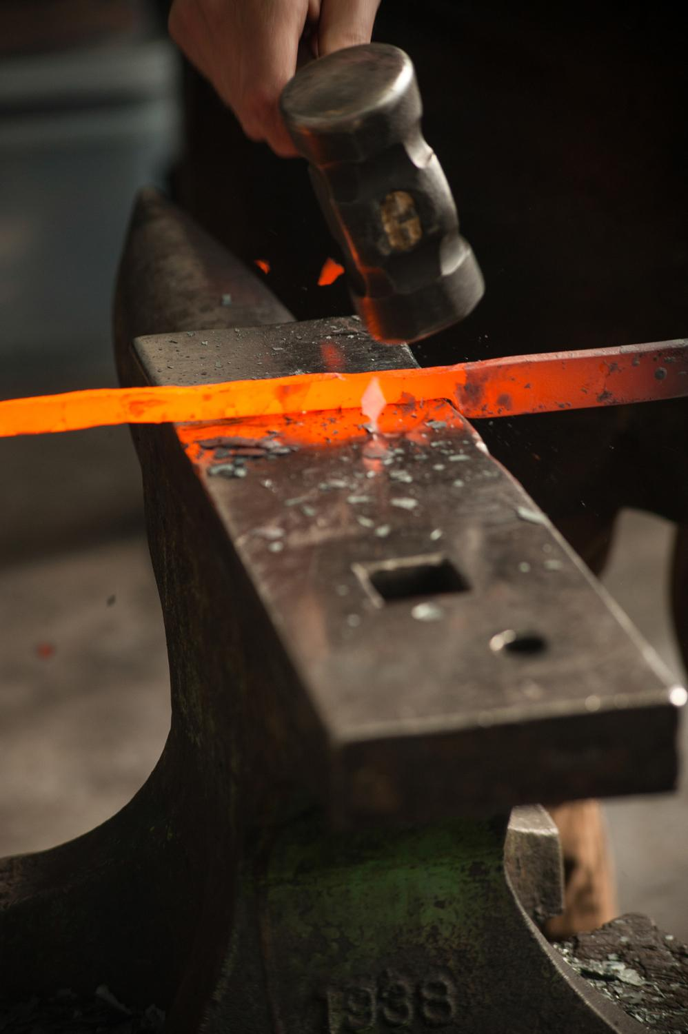 A bar of steel, blazing hot from the forge / Image: Melissa Doss Sliney