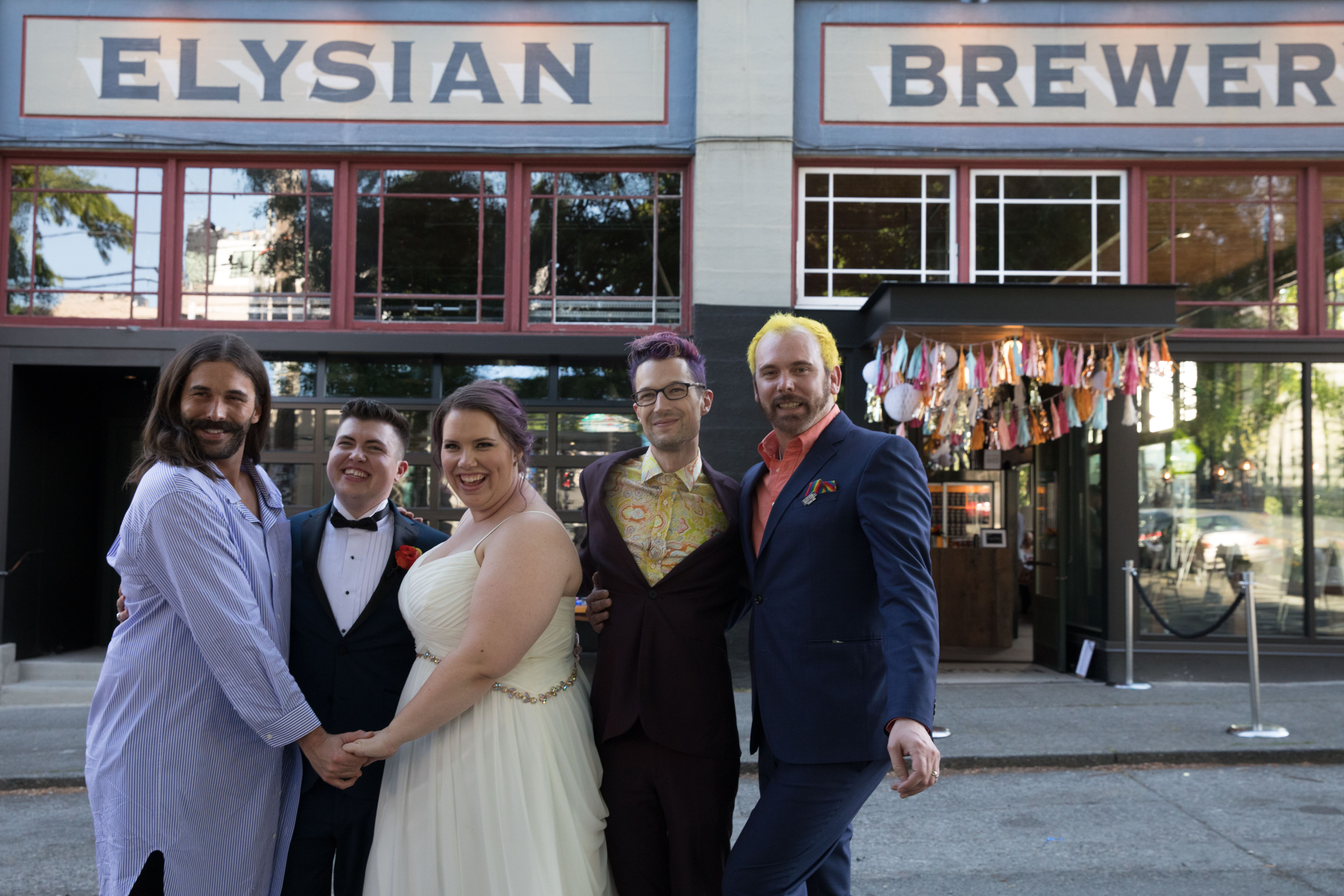 CAN YOU EVEN BELIEVE?!{ } Jonathan Van Ness (left) poses with #MarryUsVJN contest winner newlyweds, Megan (middle) and Haden (middle-left), and plaintiffs of the Masterpiece Cakeshop Supreme Court case, Charlie (right) and David (middle-right), at Elysian Brewing's Capitol Hill brewpub in Seattle on June 4, 2019.(Photo by Matt Mills McKnight/Invision for Elysian Brewing/AP Images)