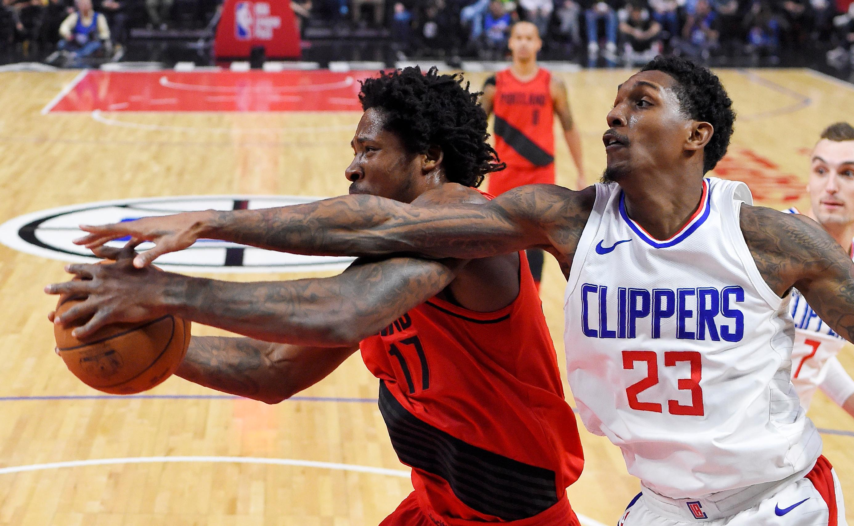 Portland Trail Blazers forward Ed Davis, left, and Los Angeles Clippers guard Lou Williams reach for a rebound during the first half of an NBA basketball game, Tuesday, Jan. 30, 2018, in Los Angeles. (AP Photo/Mark J. Terrill)