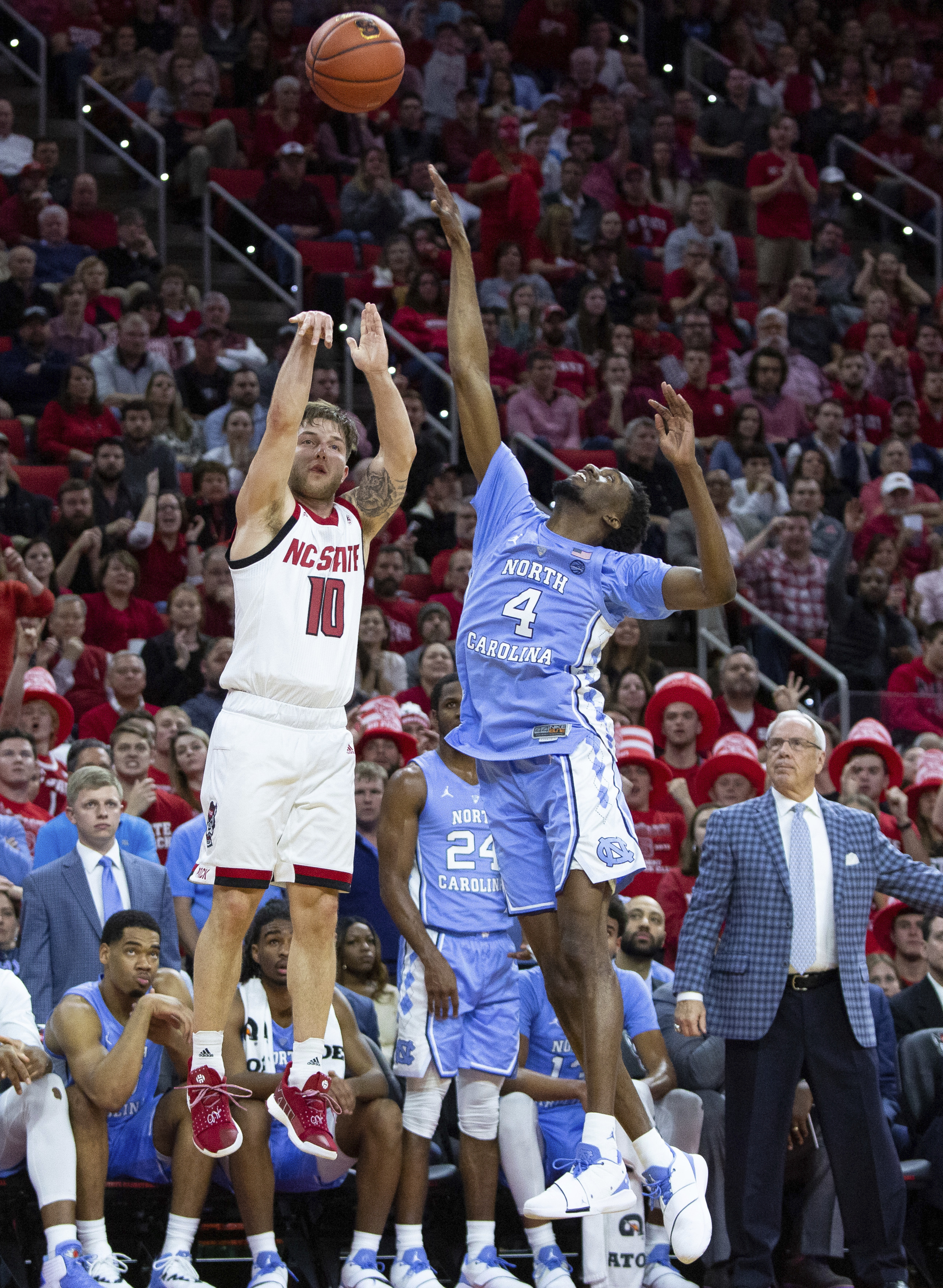 North Carolina State's Braxton Beverly (10) attempts a three-pointer over North Carolina's Brandon Robinson (4) during the first half of an NCAA college basketball game in Raleigh, N.C., Tuesday, Jan. 8, 2019. (AP Photo/Ben McKeown)