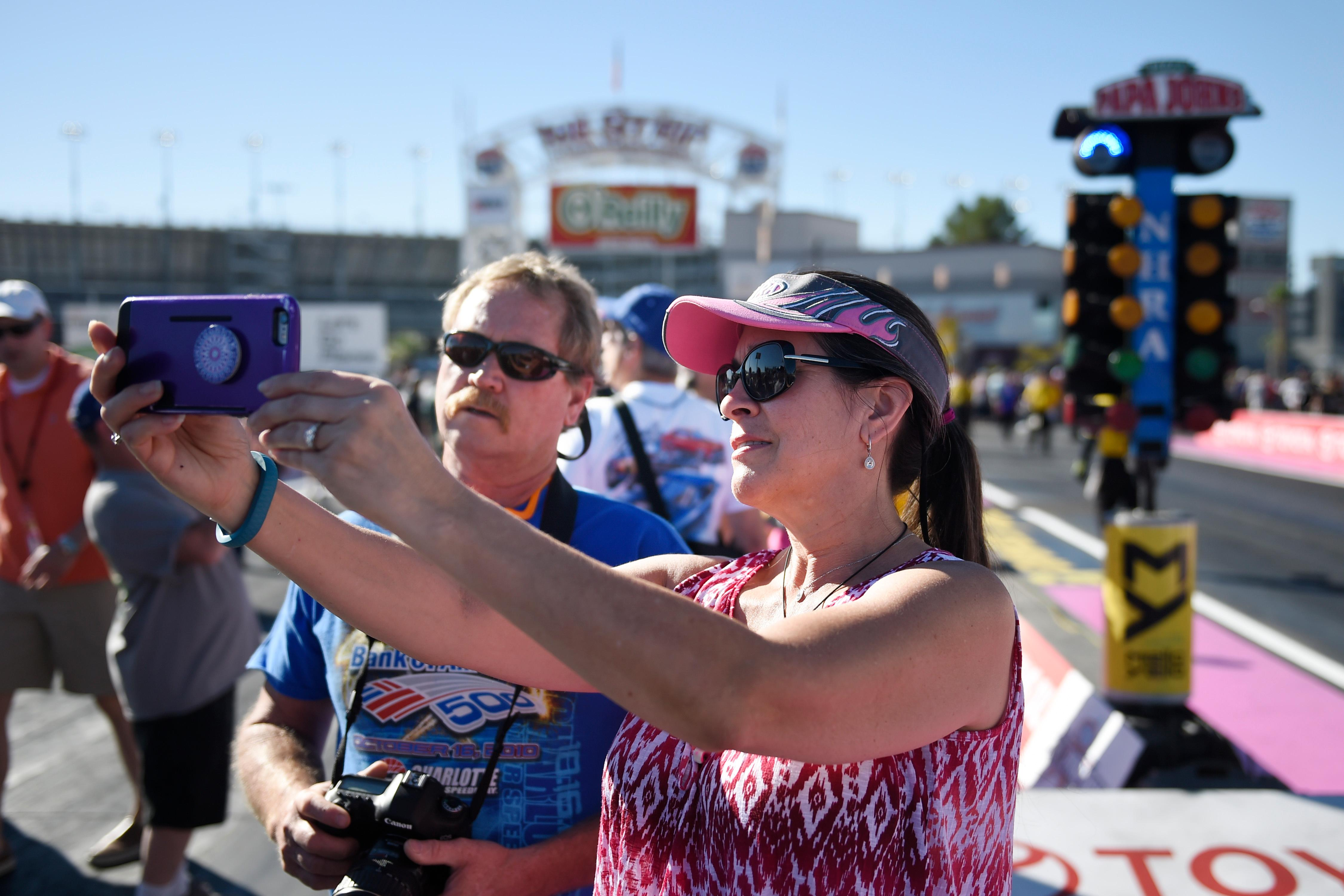 Fans take a photo during a track walk before the NHRA Toyota Nationals Sunday, October 29, 2017, at The Strip at the Las Vegas Motor Speedway. CREDIT: Sam Morris/Las Vegas News Bureau