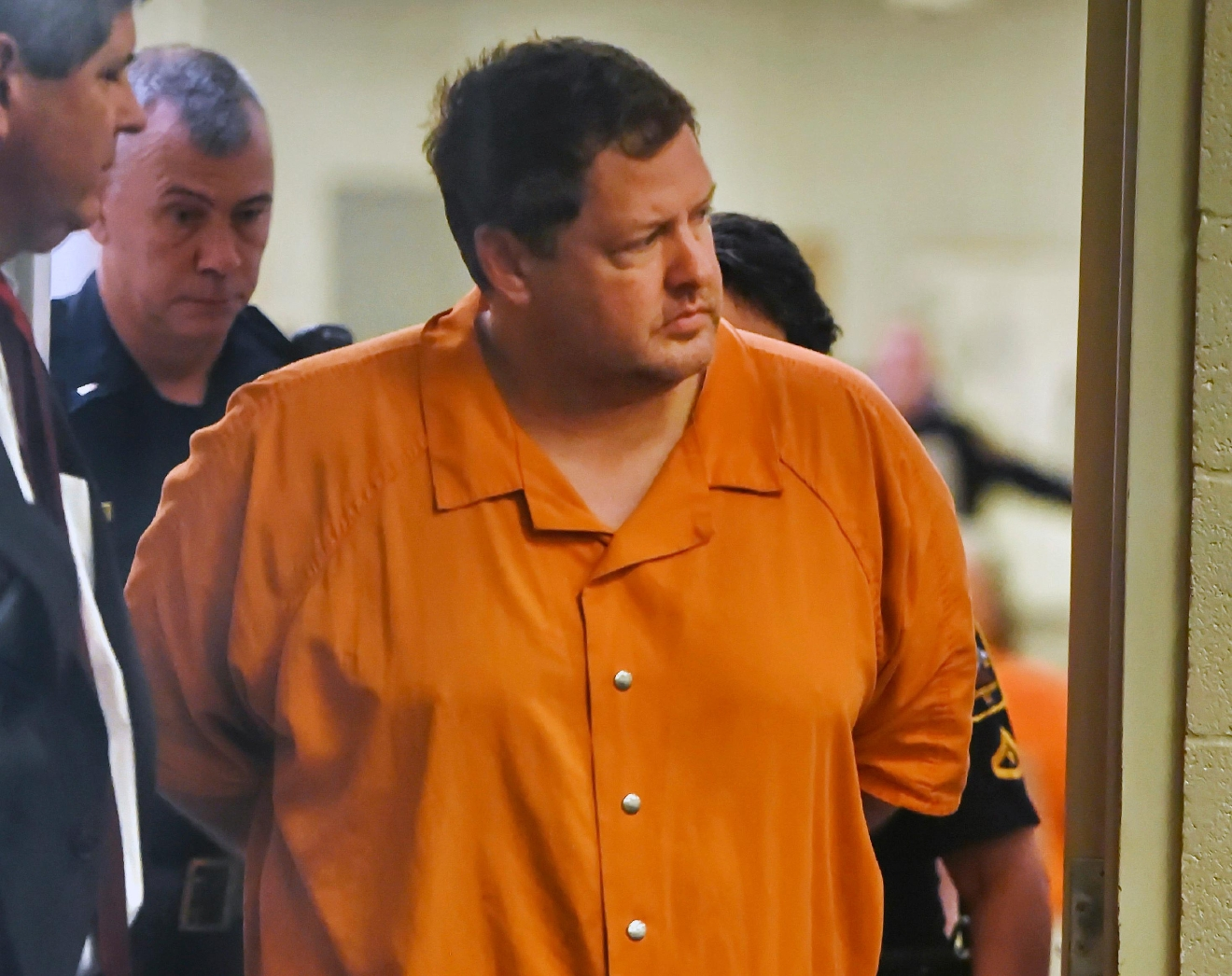 FILE - In this Sunday, Nov. 6, 2016, file photo, Todd Kohlhepp's enters the courtroom of Judge Jimmy Henson for a bond hearing at the Spartanburg Detention Facility in Spartanburg, S.C. A South Carolina woman who spent two months chained inside a metal container says her captor bragged that he was good at killing people and warned her she could be next if she fought back or ran. Brown and her boyfriend had been missing since Aug. 31, when they went to Kohlhepp's rural property, thinking they were going to clear underbrush. (AP Photo/Richard Shiro, File)