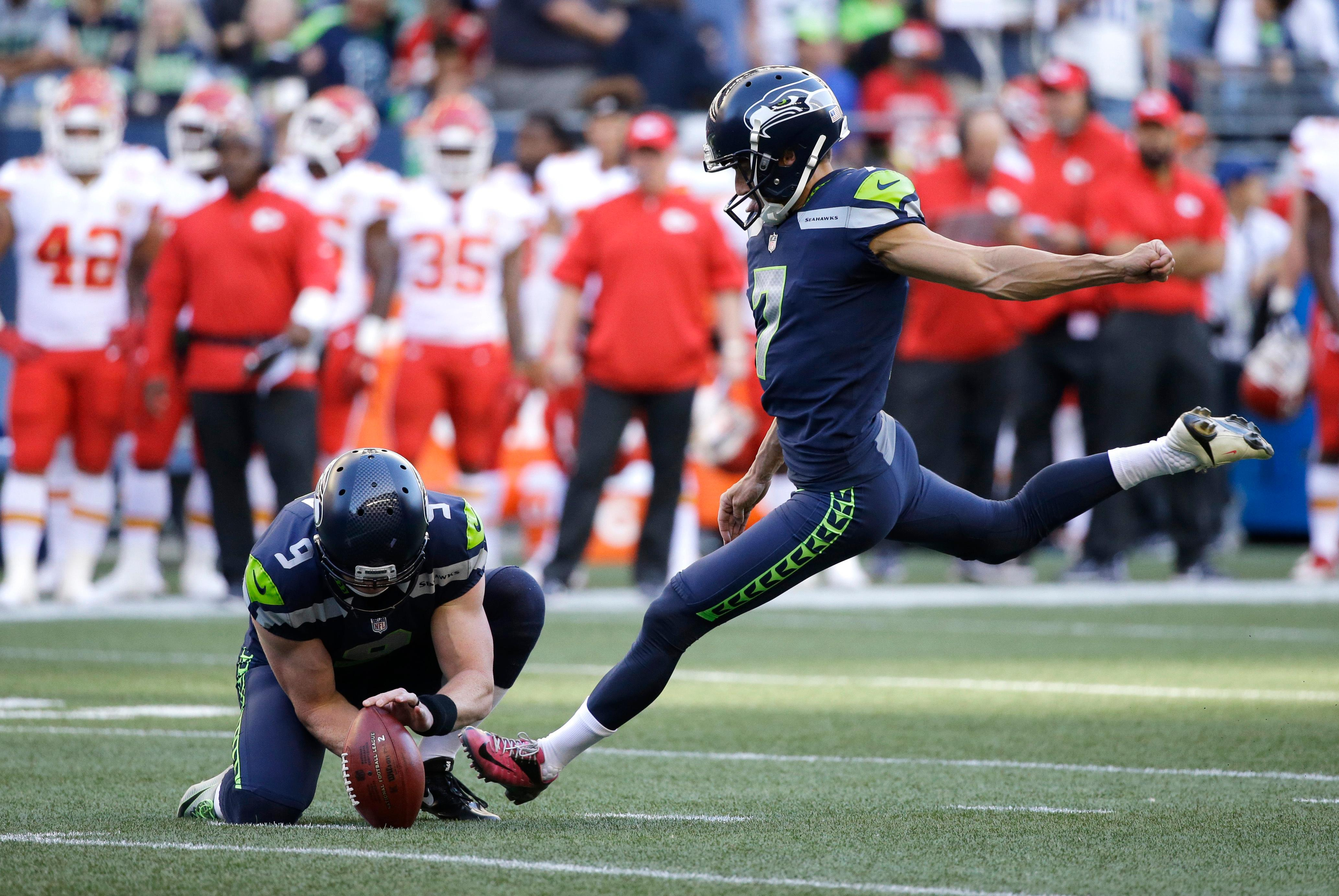 Seattle Seahawks' Blair Walsh, right, kicks a field goal against the Kansas City Chiefs as Jon Ryan (9) holds during the first half of an NFL football preseason game, Friday, Aug. 25, 2017, in Seattle. (AP Photo/Elaine Thompson)
