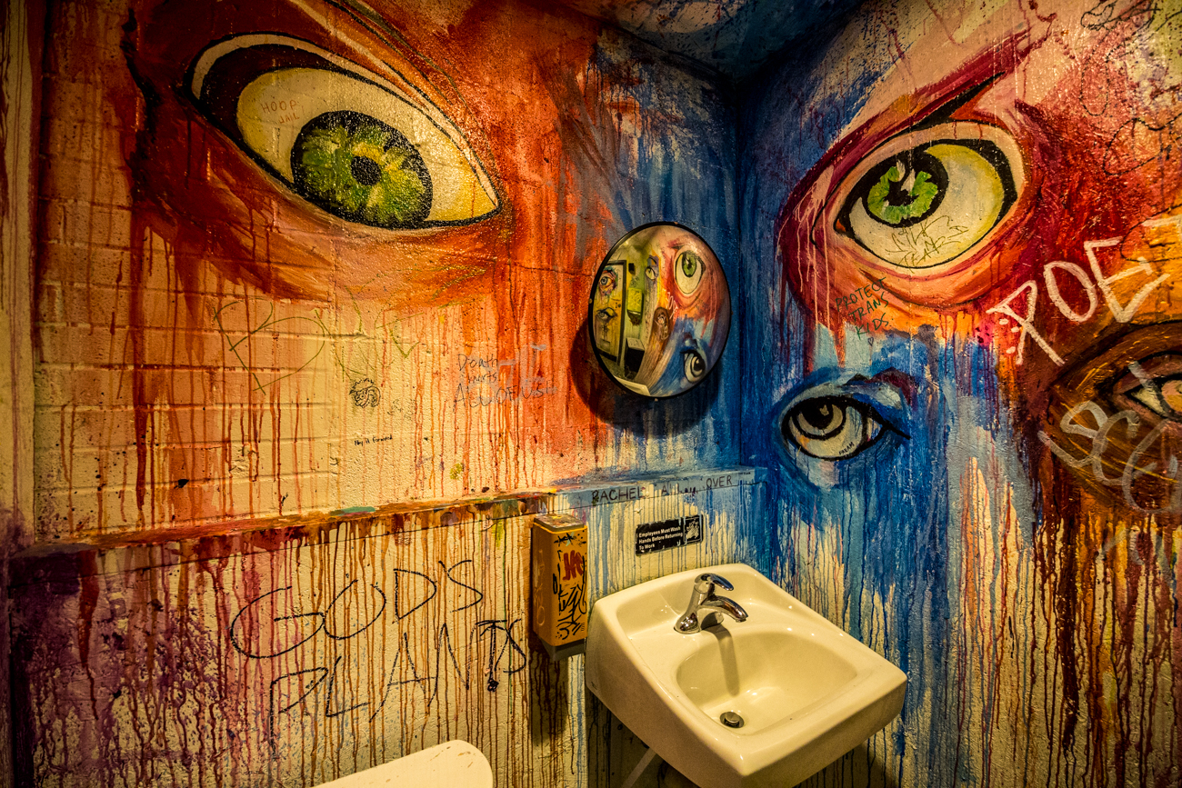 PLACE #9: Mecca / ADDRESS: 1429 Walnut Street (45202) / It should come as no surprise that Mecca has some pretty cool bathrooms, considering the bright and artistic setting at the Over-the-Rhine bar. The bathrooms are covered in plenty of color and art murals, not unlike the bar's outdoor patio, and will certainly give your bathroom selfie some imaginative bonus points. / Image: Catherine Viox // Published: 8.8.19