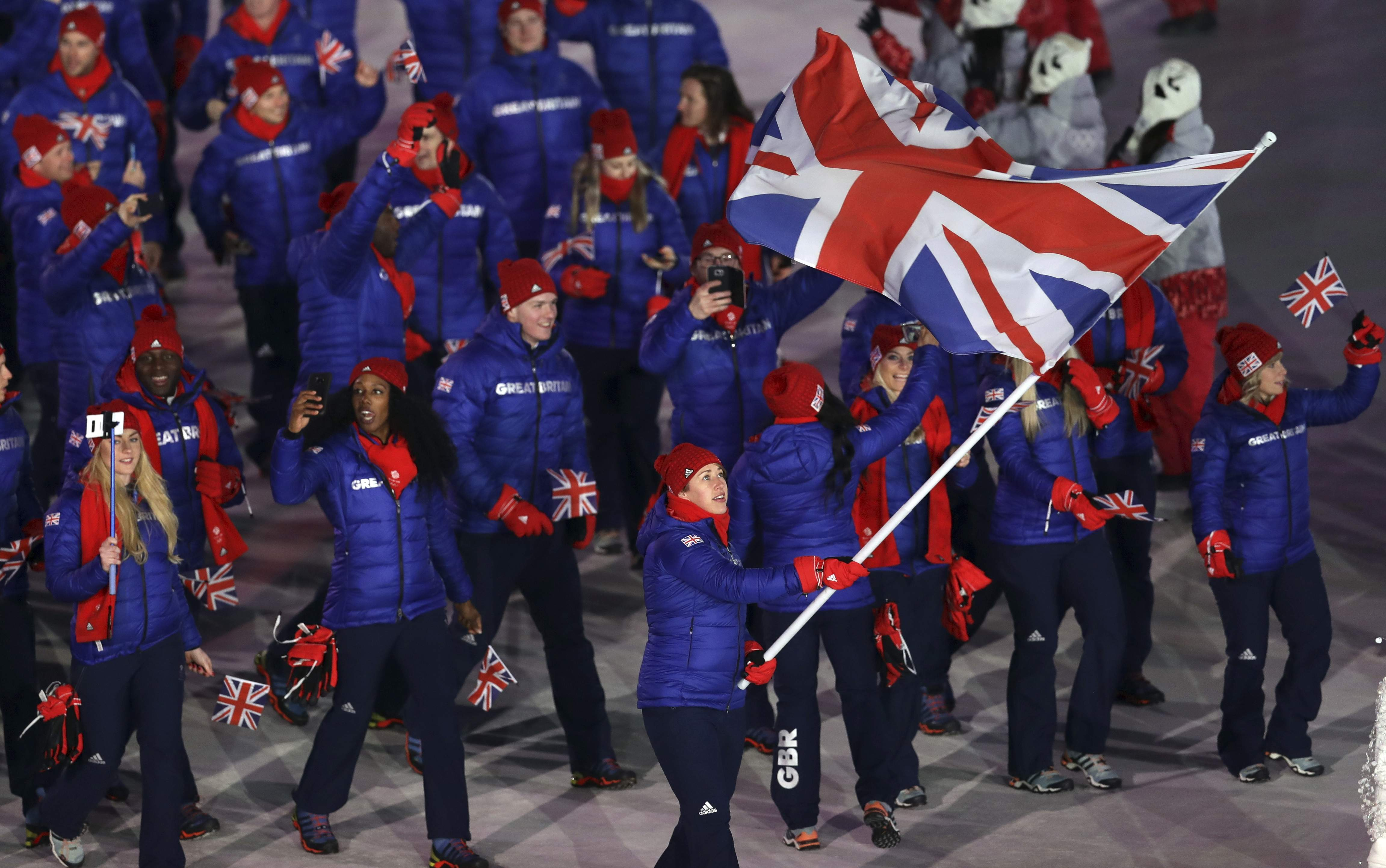 Lizzy Yarnold carries the flag of Britain during the opening ceremony of the 2018 Winter Olympics in Pyeongchang, South Korea, Friday, Feb. 9, 2018. (AP Photo/Michael Sohn)